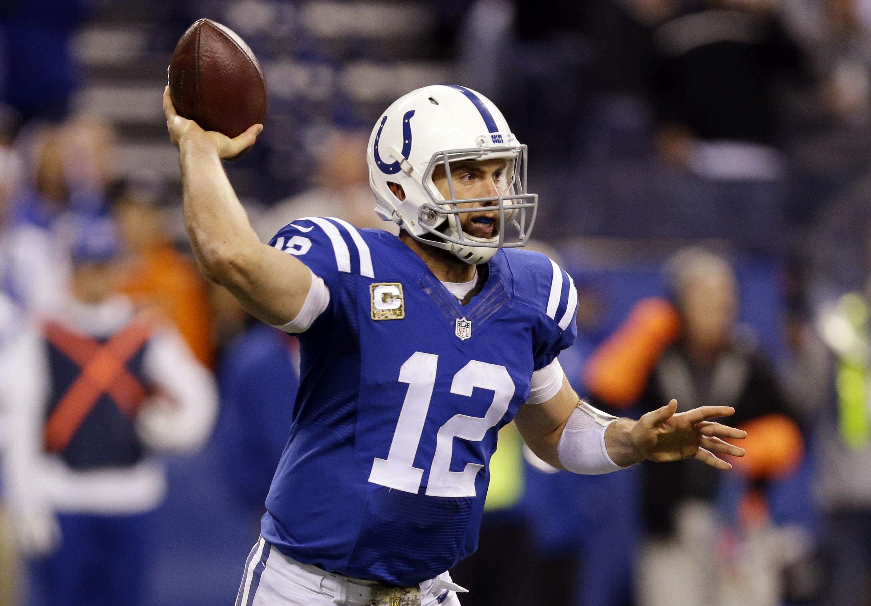 Indianapolis Colts' Andrew Luck  throws during the second half of an NFL football game against the Denver Broncos, Sunday, Nov. 8, 2015, in Indianapolis.  Luck is expected to miss two to six weeks after sustaining a lacerated kidney and torn abdominal mus