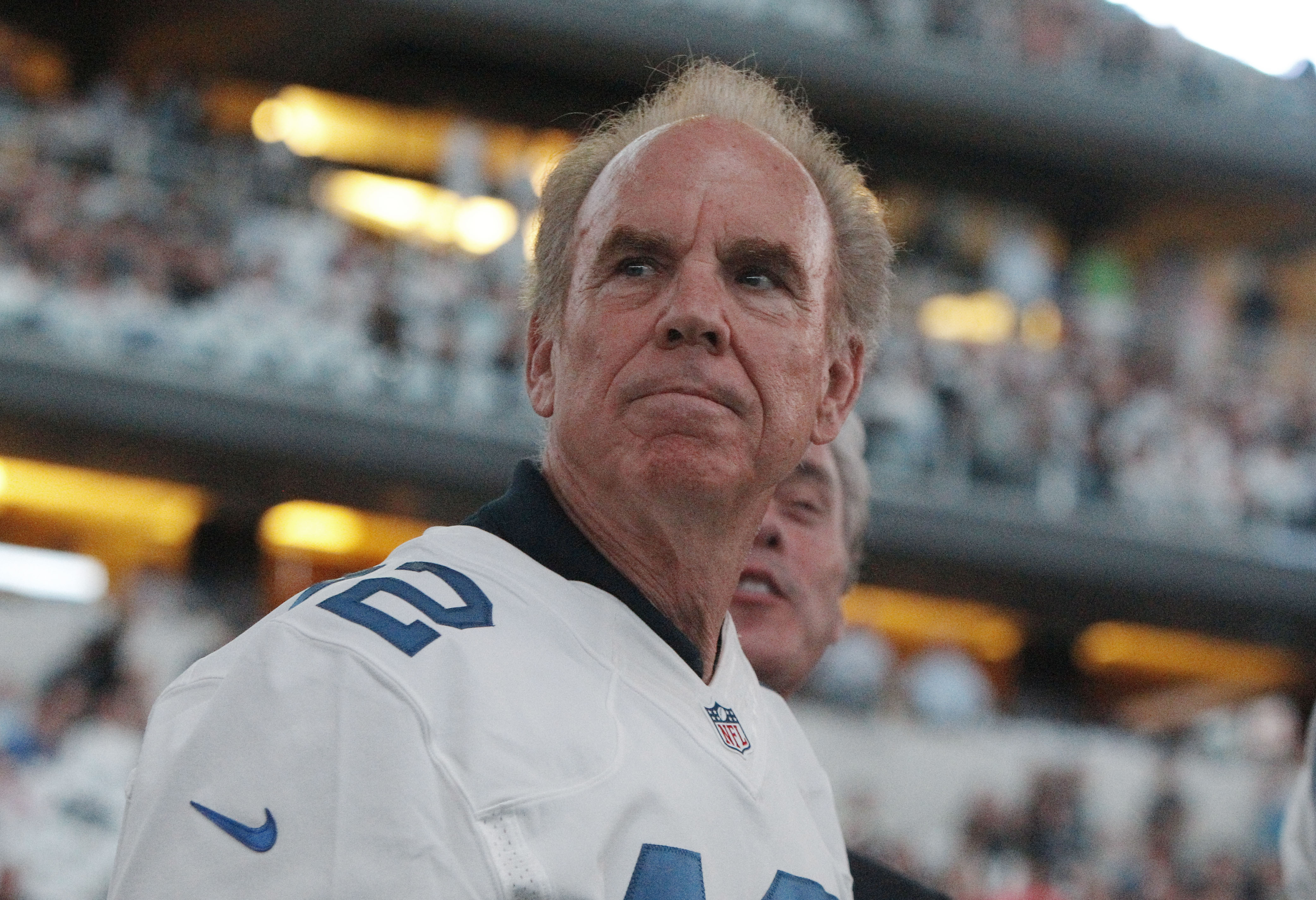 FILE - In this Oct. 27, 2014, file photo, former Dallas Cowboys quarterback Roger Staubach looks on from the sidelines before the start of the first half of an NFL football game against the Washington Redskins, in Arlington, Texas. Before winning two Supe
