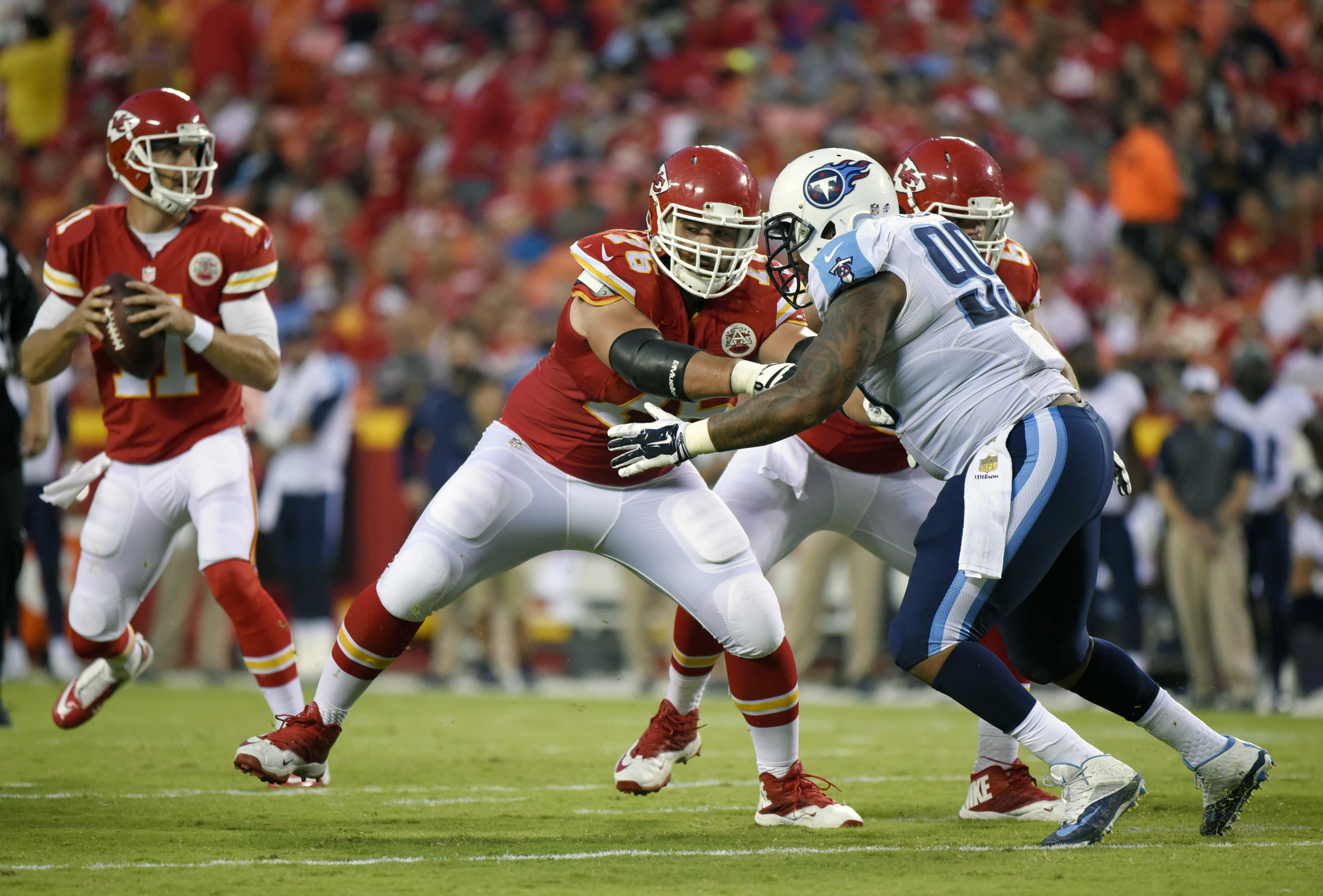 FILE - In this Aug. 28, 2015, file photo, Kansas City Chiefs offensive lineman Laurent Duvernay-Tardif (76), center,  blocks Tennessee Titans defensive tackle Jurrell Casey (99) during the first half of a preseason NFL football game at Arrowhead Stadium i