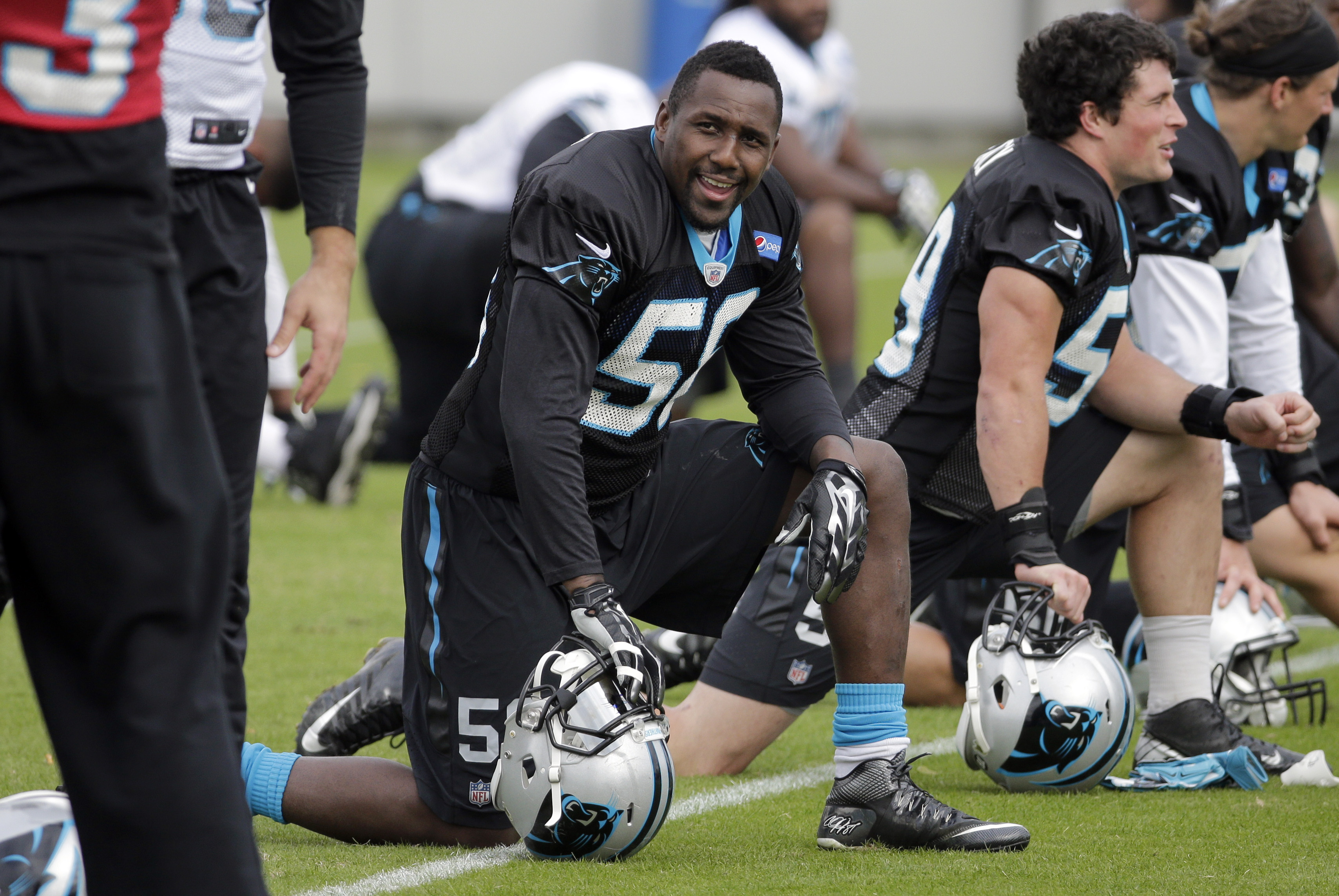 Carolina Panthers' Thomas Davis (58) smiles as he stretches with the team before an NFL football practice in Charlotte, N.C., Thursday, Nov. 12, 2015. (AP Photo/Chuck Burton)
