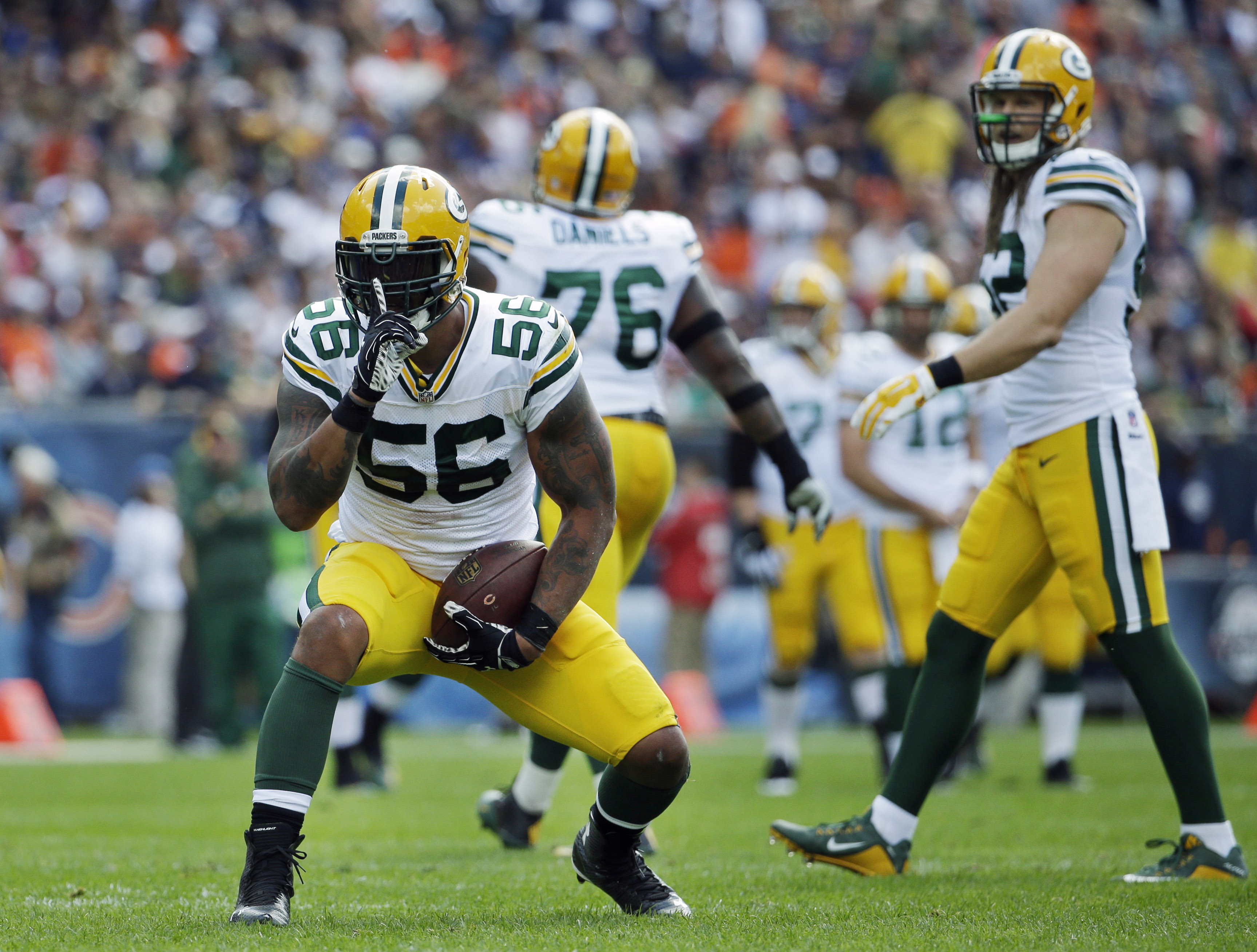 FILE - In this Sept. 13, 2015, file photo, Green Bay Packers outside linebacker Julius Peppers (56) reacts after sacking Chicago Bears quarterback Jay Cutler during the first half an NFL football game,  in Chicago. After a productive first six games, the