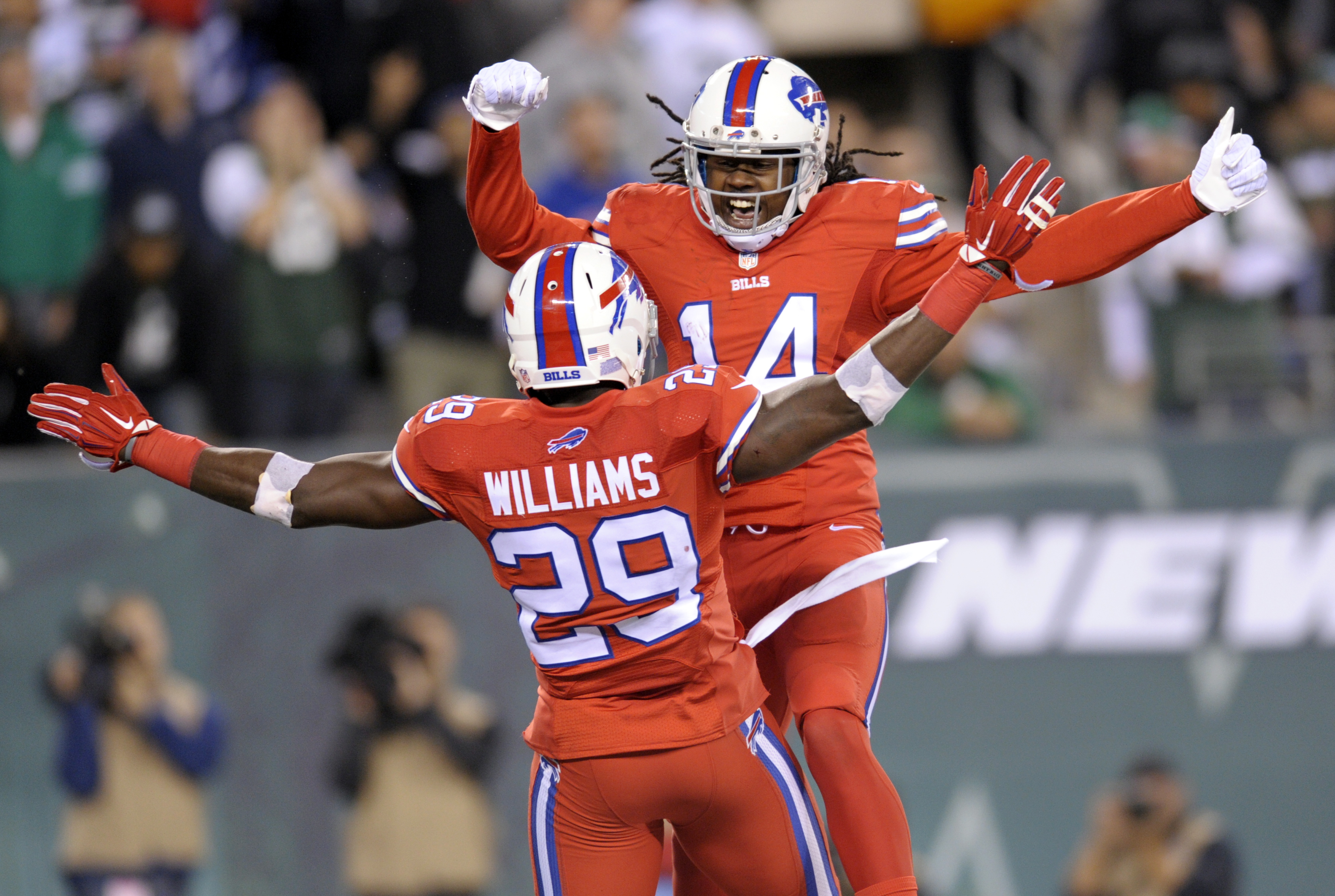 Buffalo Bills running back Karlos Williams, front, and wide receiver Sammy Watkins celebrate Williams' touchdown catch against the New York Jets during the second half of an NFL football game, Thursday, Nov. 12, 2015, in East Rutherford, N.J. (AP Photo/Bi