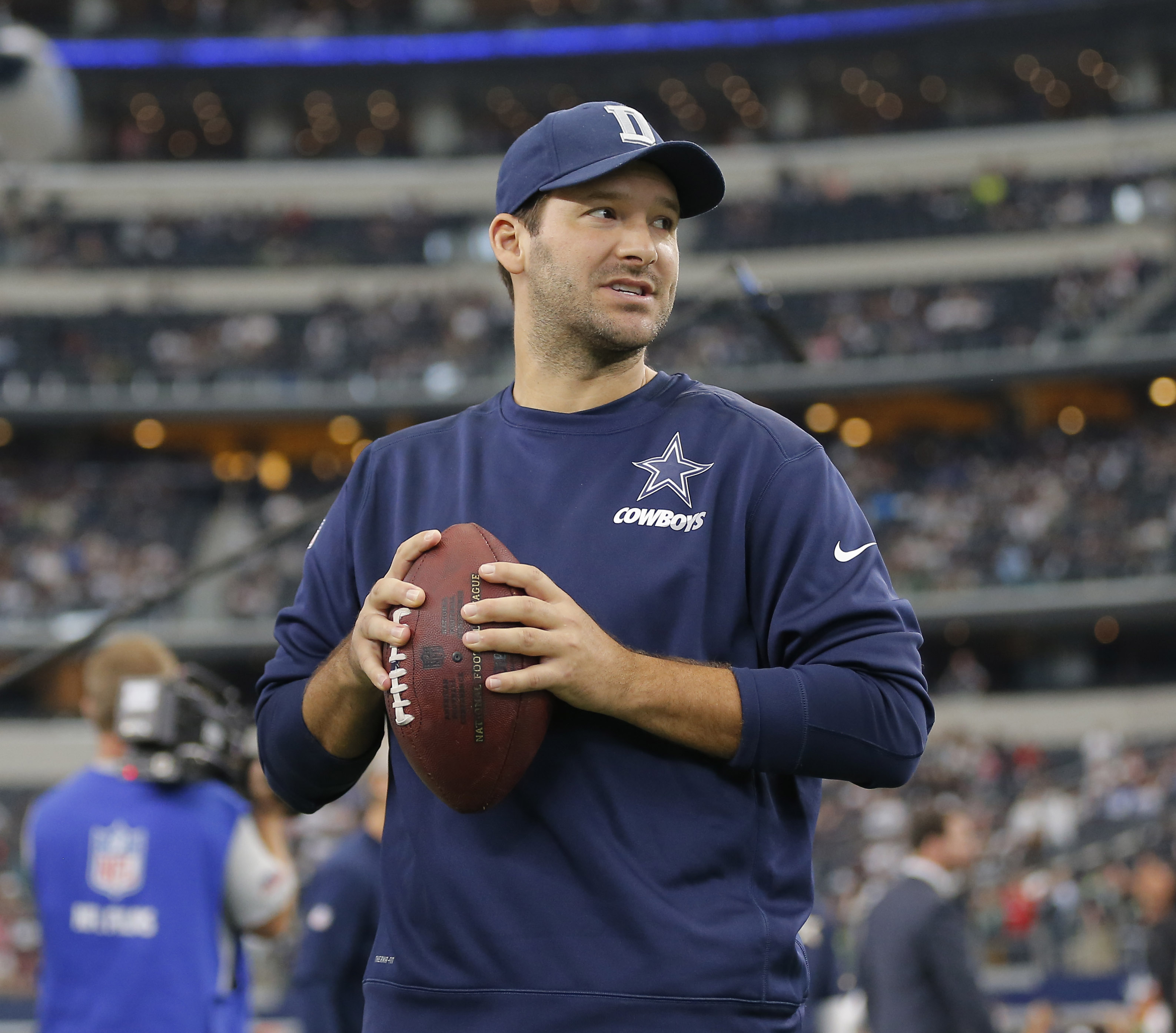 FILE - In this Nov. 1, 2015, file photo, injured Dallas Cowboys quarterback Tony Romo is shown prior to an NFL football game in Arlington, Texas. Tony Romo, scout team quarterback. That's the best the Dallas star could do the past two weeks in his return