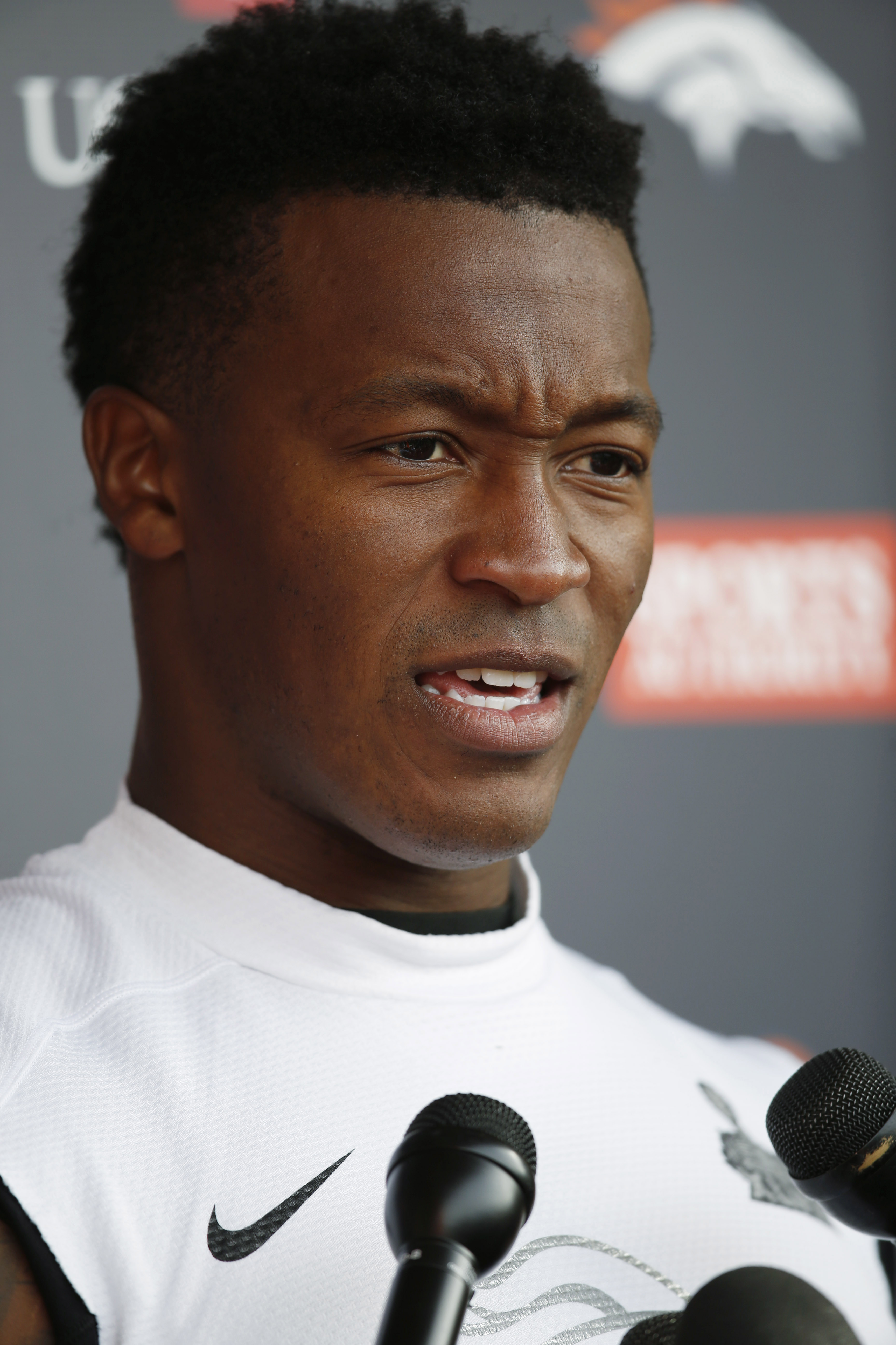 FILE - In this Wednesday, Nov. 4, 2015, file photograph, Denver Broncos wide receiver Demaryius Thomas talks to reporters after NFL practice session at the team's headquarters in Englewood, Colo. Thomas, who had hoped to have his mother, Katina Smith, fly