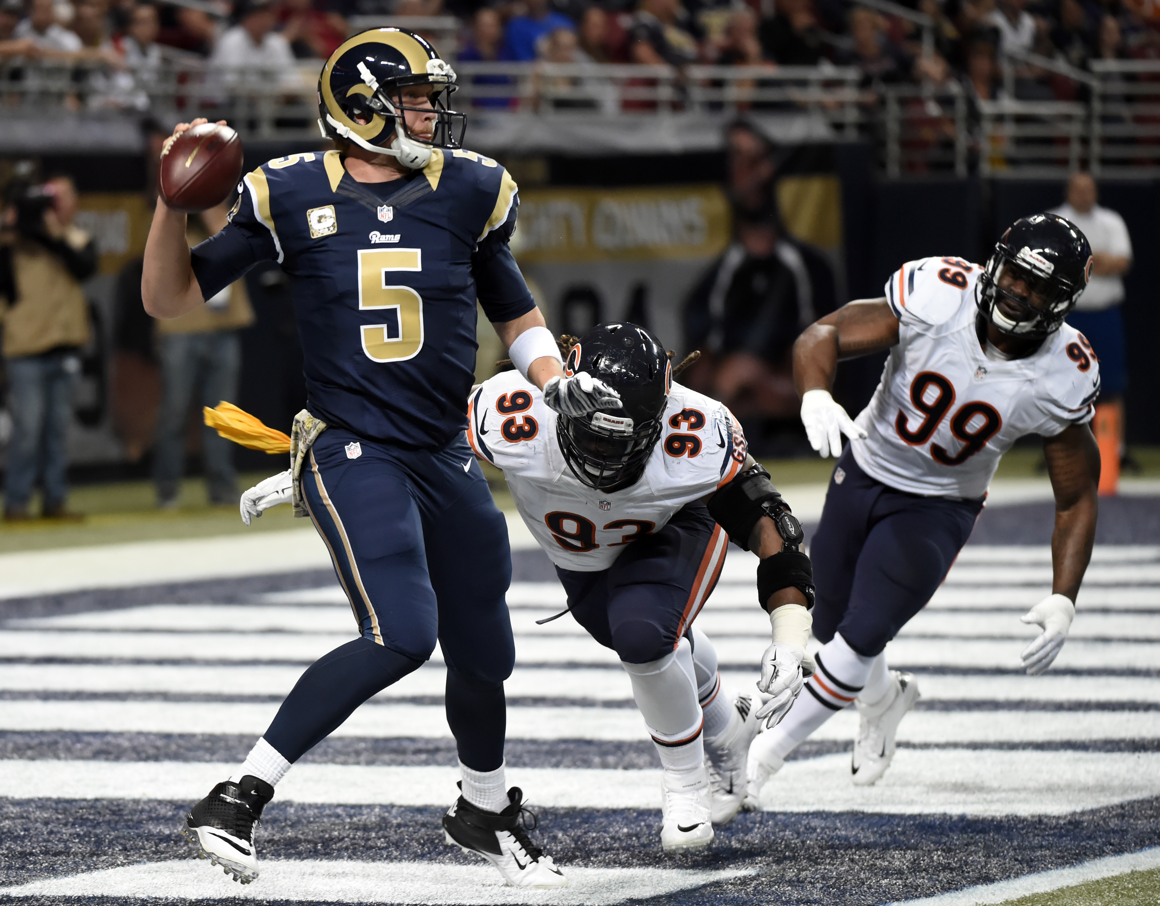 St. Louis Rams quarterback Nick Foles, left, scrambles away from Chicago Bears defenders Will Sutton (93) and Lamarr Houston (99) during the second quarter of an NFL football game Sunday, Nov. 15, 2015, in St. Louis. (AP Photo/L.G. Patterson)