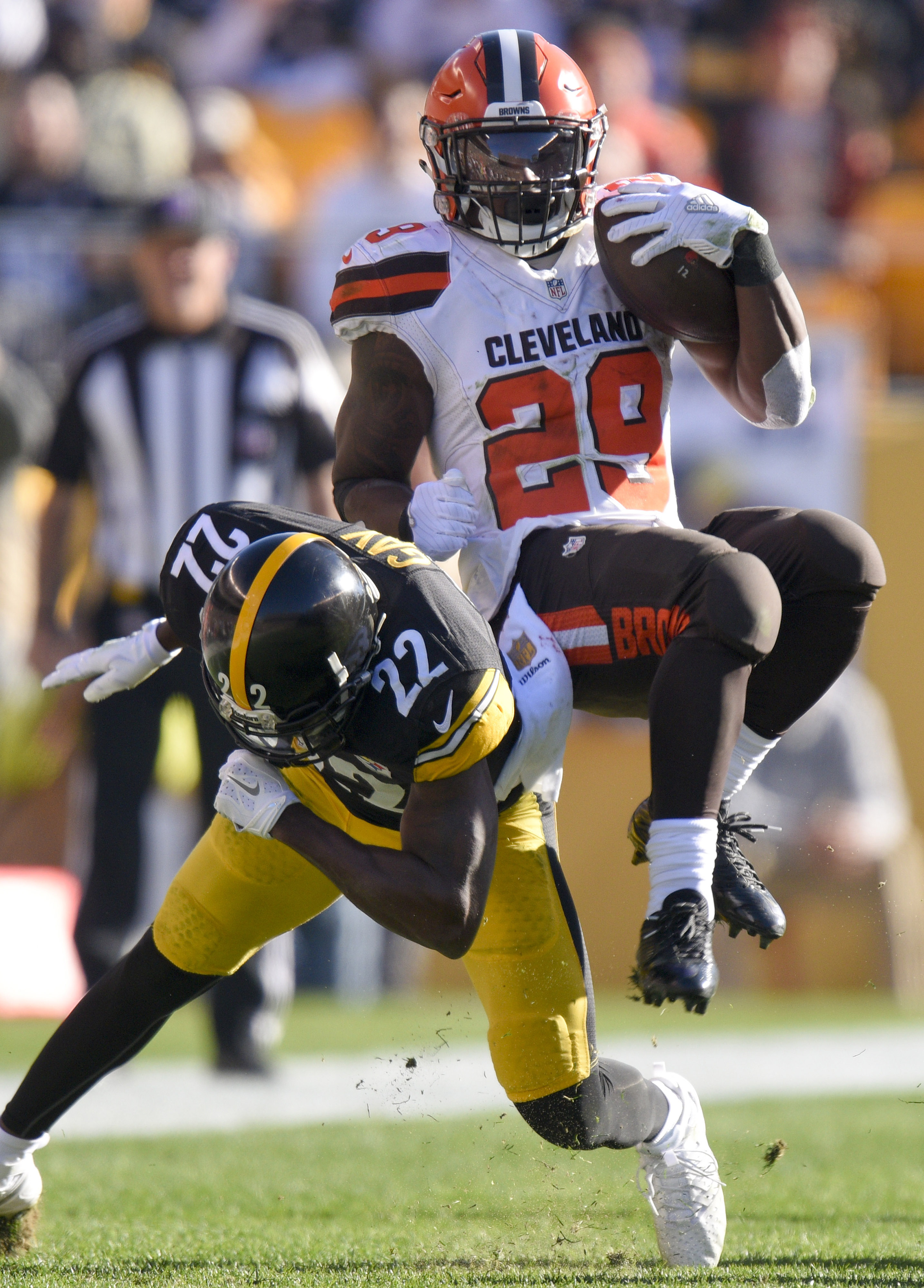 Cleveland Browns cornerback Tramon Williams (22) spins away from Pittsburgh Steelers cornerback William Gay (22) after being hit in the first half of an NFL football game, Sunday, Nov. 15, 2015, in Pittsburgh. (AP Photo/Don Wright)