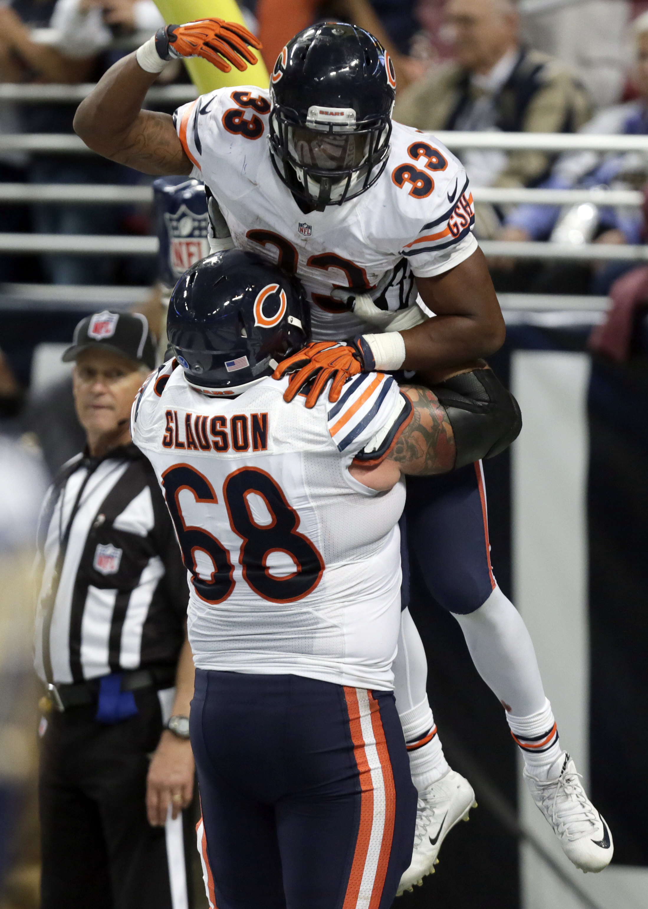 Chicago Bears running back Jeremy Langford (33) is congratulated by teammate Matt Slauson after scoring on a 6-yard run during the fourth quarter of an NFL football game against the St. Louis Rams Sunday, Nov. 15, 2015, in St. Louis. (AP Photo/Tom Gannam)