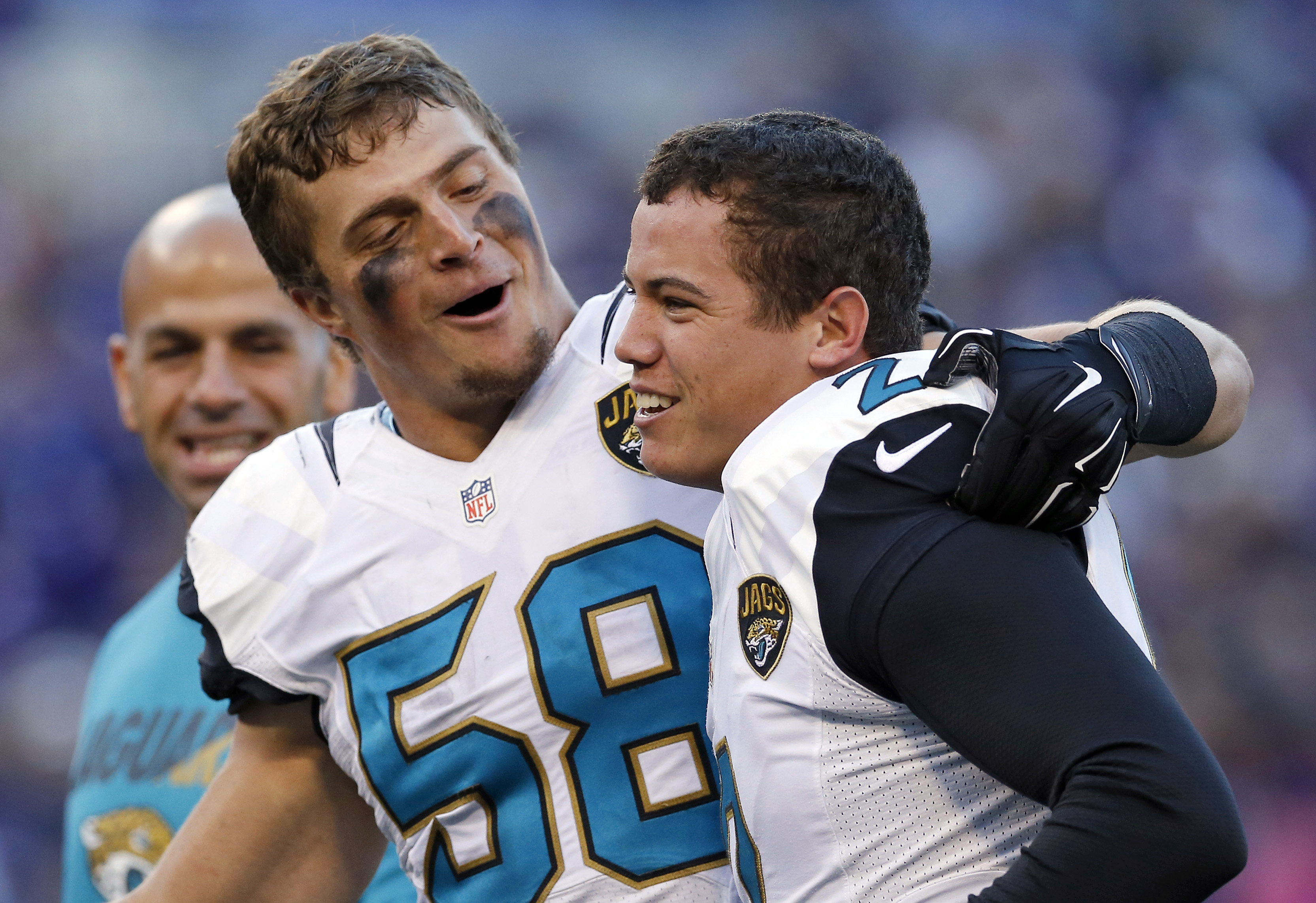Jacksonville Jaguars linebacker Jordie Tripp, left, celebrates with kicker Jason Myers after Myers kicked the game-winning field goal in the final moments of an NFL football game against the Baltimore Ravens, Sunday, Nov. 15, 2015, in Baltimore. Jacksonvi