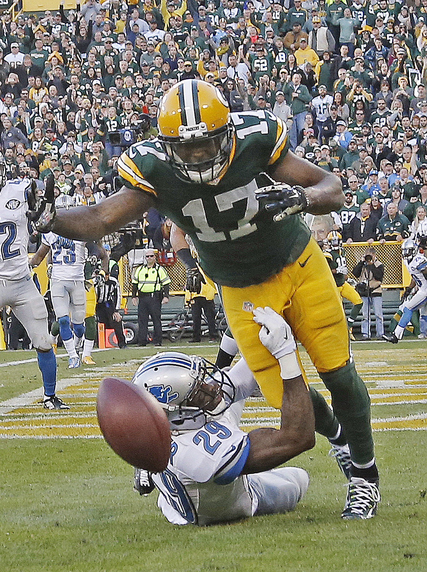 Detroit Lions' Crezdon Butler breaks up a two-point conversion intended for Green Bay Packers' Davante Adams (17) during the second half of an NFL football game Sunday, Nov. 15, 2015, in Green Bay, Wis. The Lions won 18-16. (AP Photo/Morry Gash)