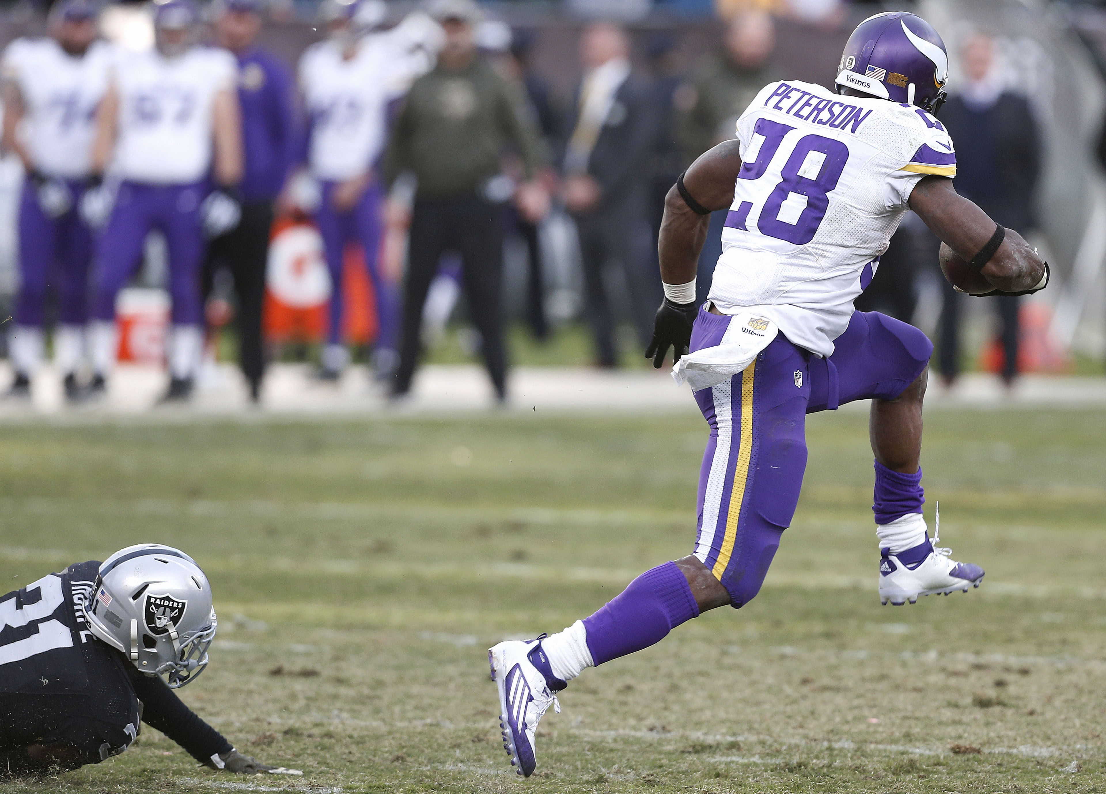 Minnesota Vikings running back Adrian Peterson (28) runs past Oakland Raiders defensive back Neiko Thorpe (31) for an 80-yard touchdown run during the second half of an NFL football game in Oakland, Calif., Sunday, Nov. 15, 2015. (AP Photo/Beck Diefenbach