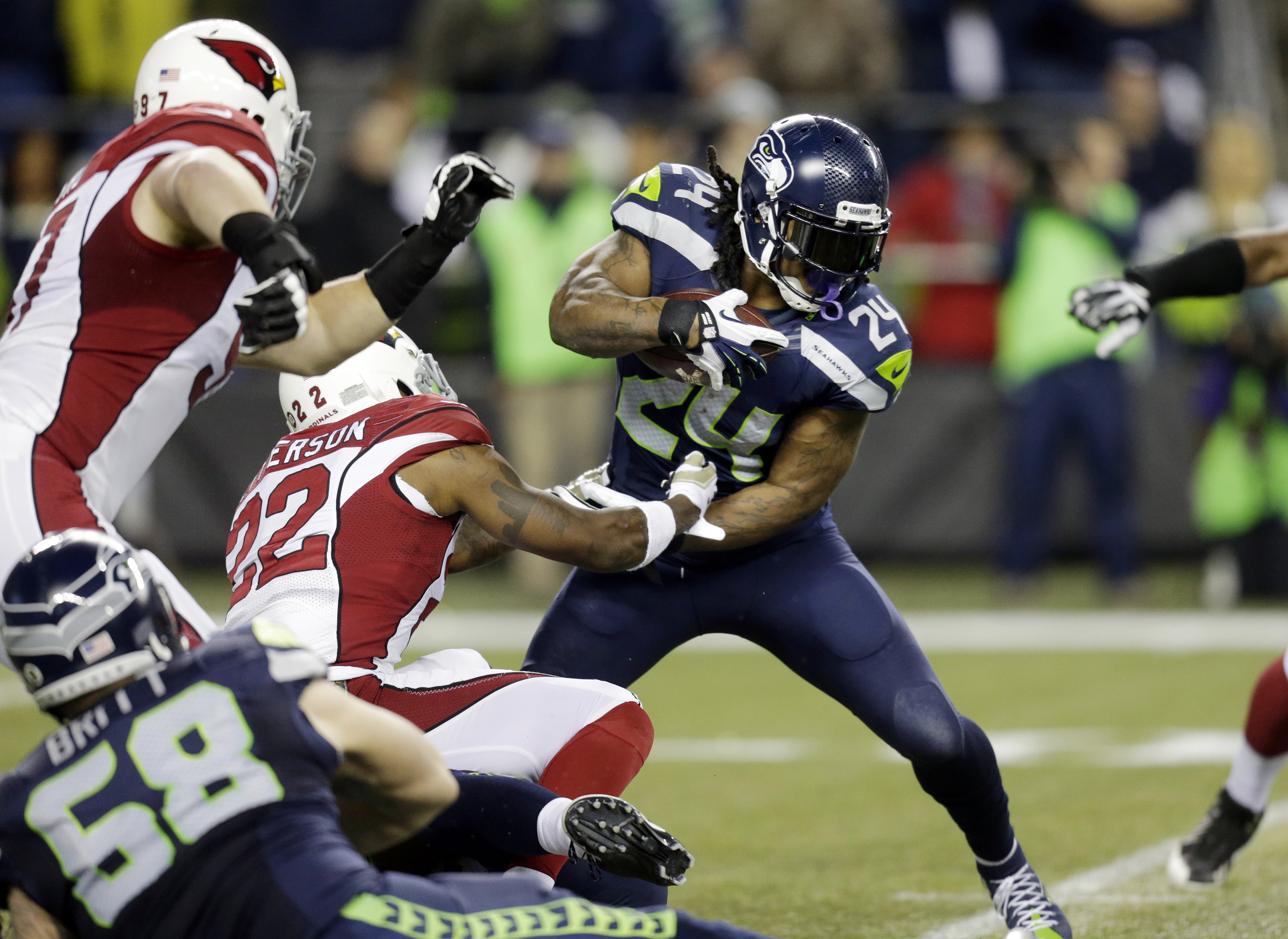 Seattle Seahawks running back Marshawn Lynch (24) rushes as Arizona Cardinals strong safety Tony Jefferson (22) attempts the tackle in the first half of an NFL football game Sunday, Nov. 15, 2015, in Seattle. (AP Photo/Stephen Brashear)