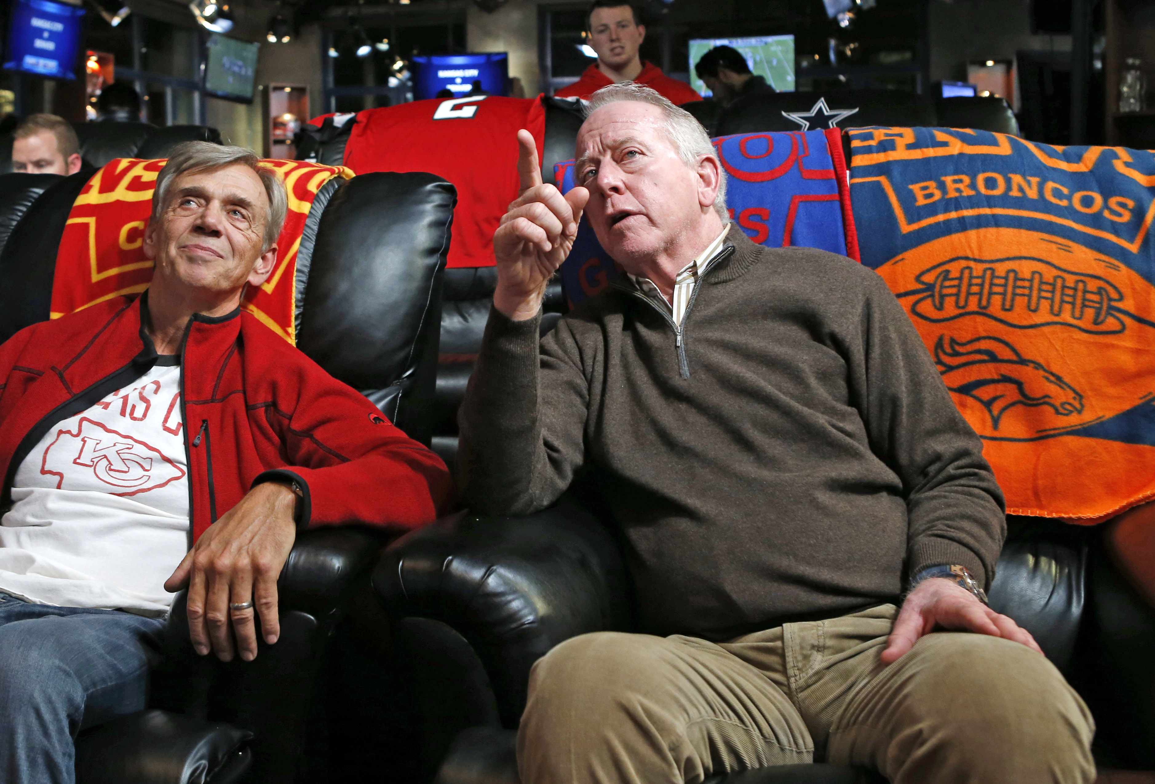 Doug Smith, left, father of Kansas City Chiefs quarterback Alex Smith, talks to Archie Manning, father of Denver Broncos quarterback Peyton Manning and New York Giants quarterback Eli Manning, during halftime of an NFL football game in which the Chiefs fa