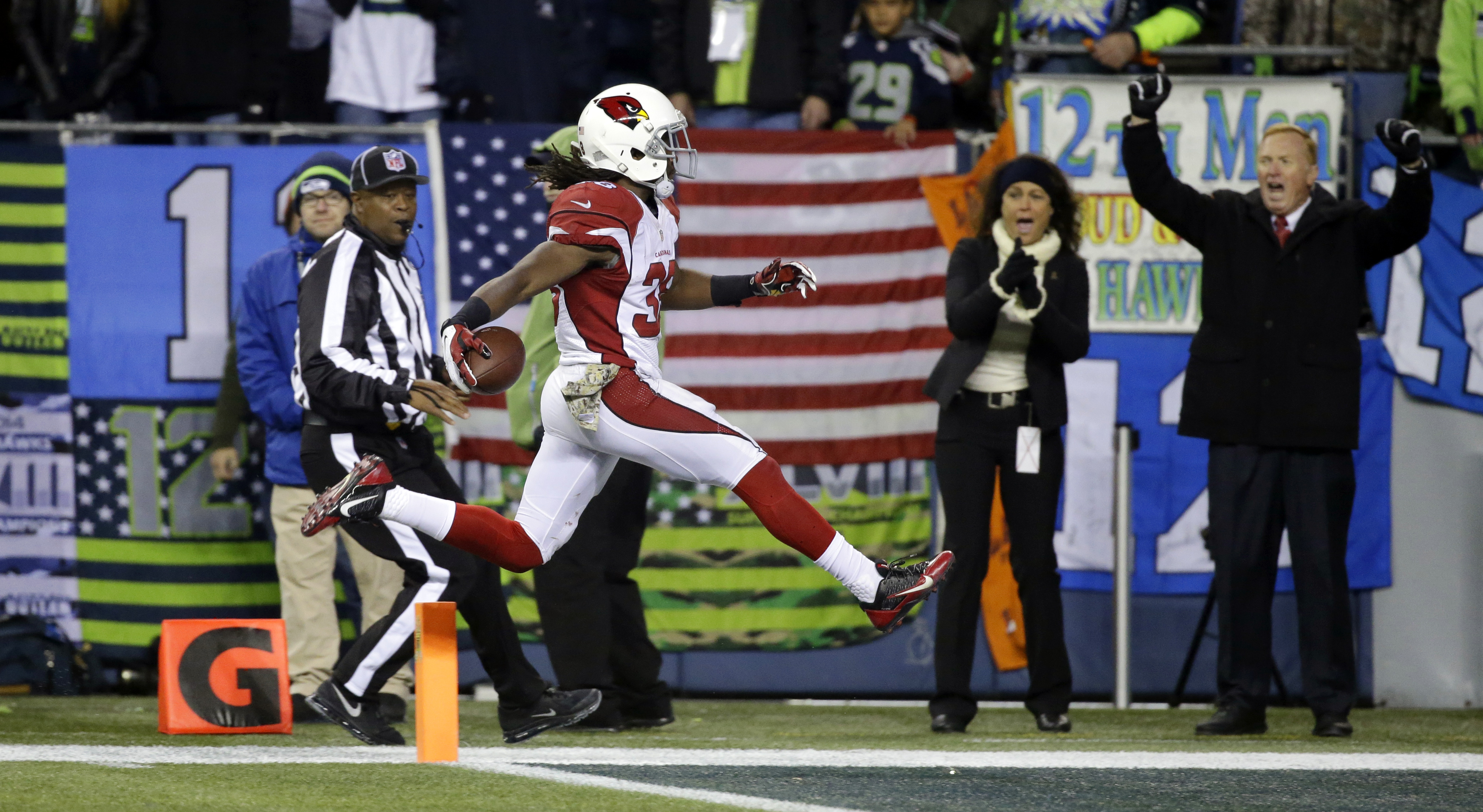 Arizona Cardinals running back Andre Ellington leaps into the end zone for a touchdown against the Seattle Seahawks during the second half of an NFL football game, Sunday, Nov. 15, 2015, in Seattle. (AP Photo/Elaine Thompson)