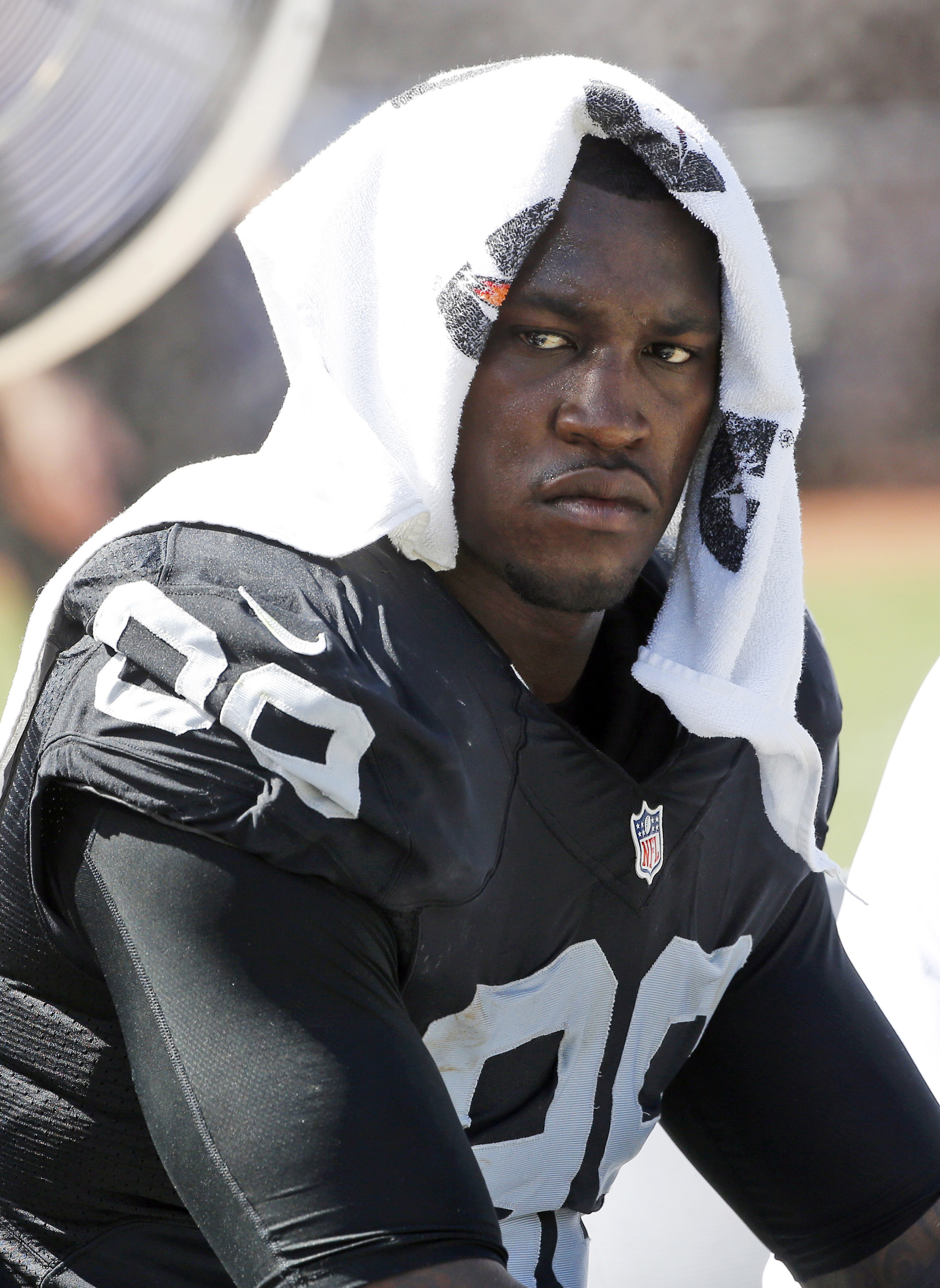 FILE - In this Sunday, Sept. 20, 2015 file photo, Oakland Raiders defensive end Aldon Smith (99) cools off during an NFL football game against the Baltimore Ravens in Oakland, Calif. Oakland Raiders linebacker Aldon Smith was suspended Tuesday, Nov. 17, 2