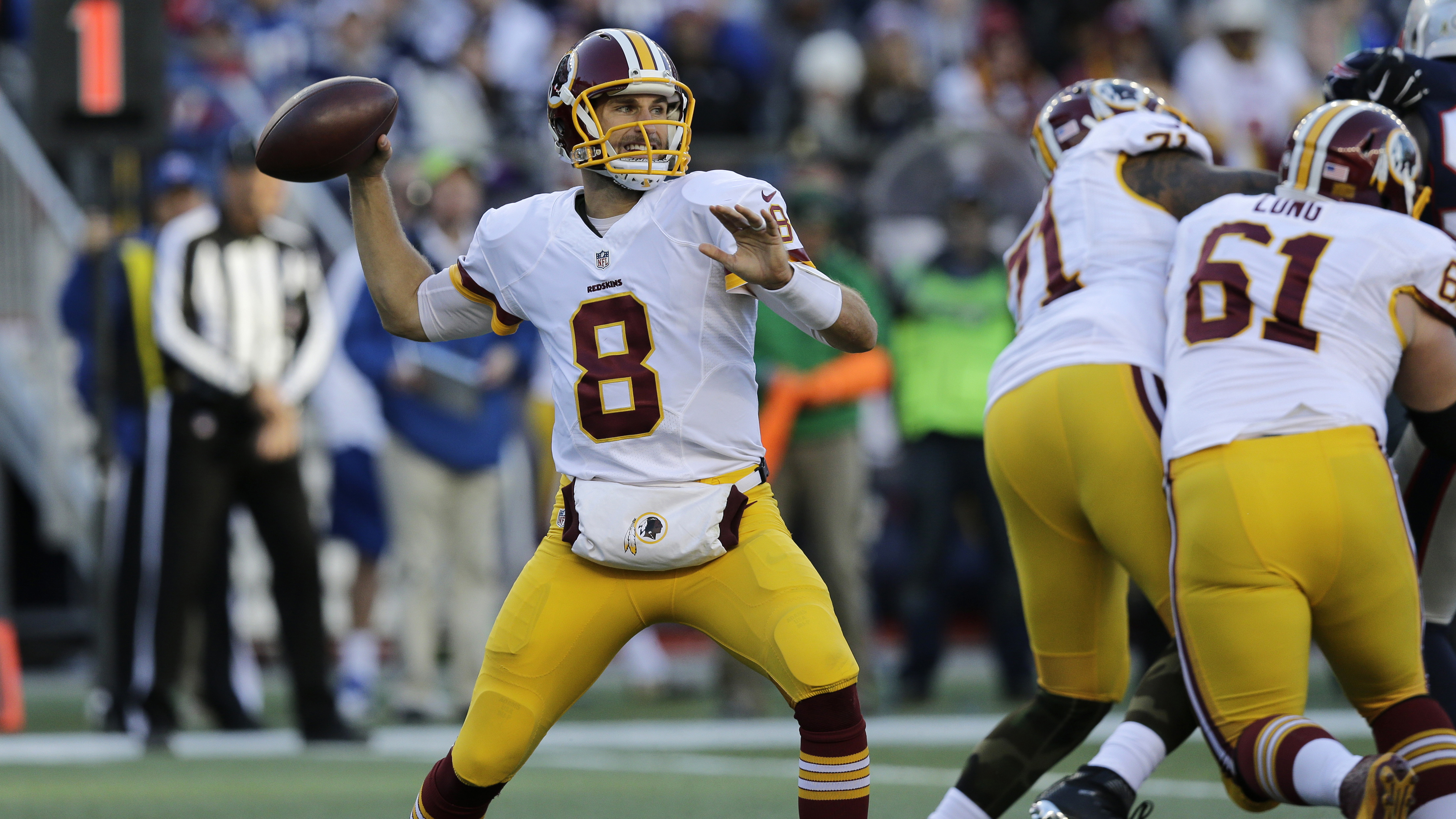 In this photo taken Nov. 8, 2015, Washington Redskins quarterback Kirk Cousins (8) throws during the second half of an NFL football game against the New England Patriots in Foxborough, Mass. Now that Kirk Cousins has his first four-TD game and his first p