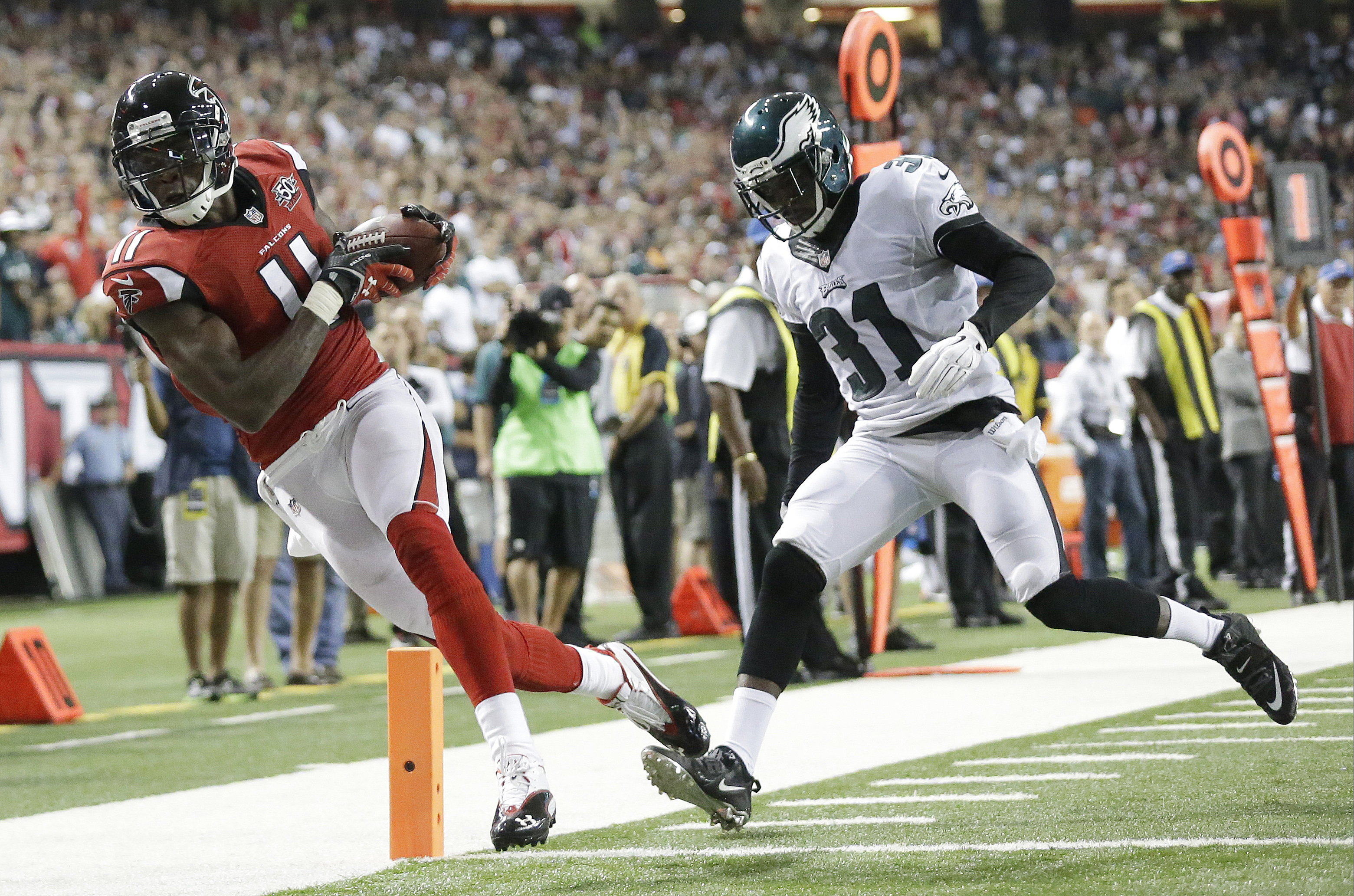 FILE - In this Sept. 14, 2015, file photo, Atlanta Falcons wide receiver Julio Jones (11) makes a touchdown catch against Philadelphia Eagles defensive back Byron Maxwell (31) during the first half of an NFL football game, in Atlanta. Julio Jones is on pa