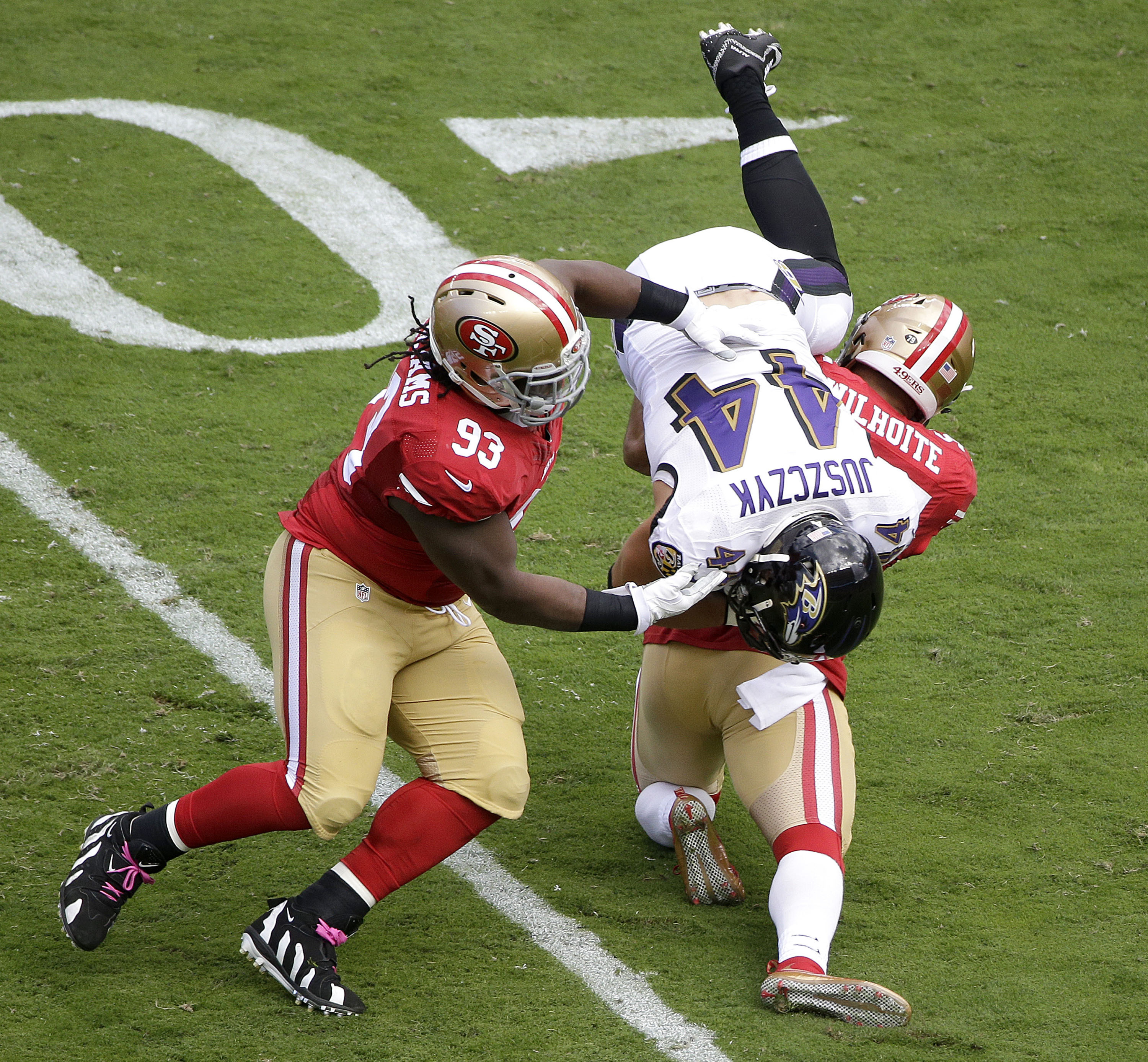 FILE - In this Sunday, Oct. 18, 2015 file photo, Baltimore Ravens fullback Kyle Juszczyk (44) is tackled by San Francisco 49ers nose tackle Ian Williams (93) during the first half of an NFL football game in Santa Clara, Calif. Ian Williams passed NaVorro