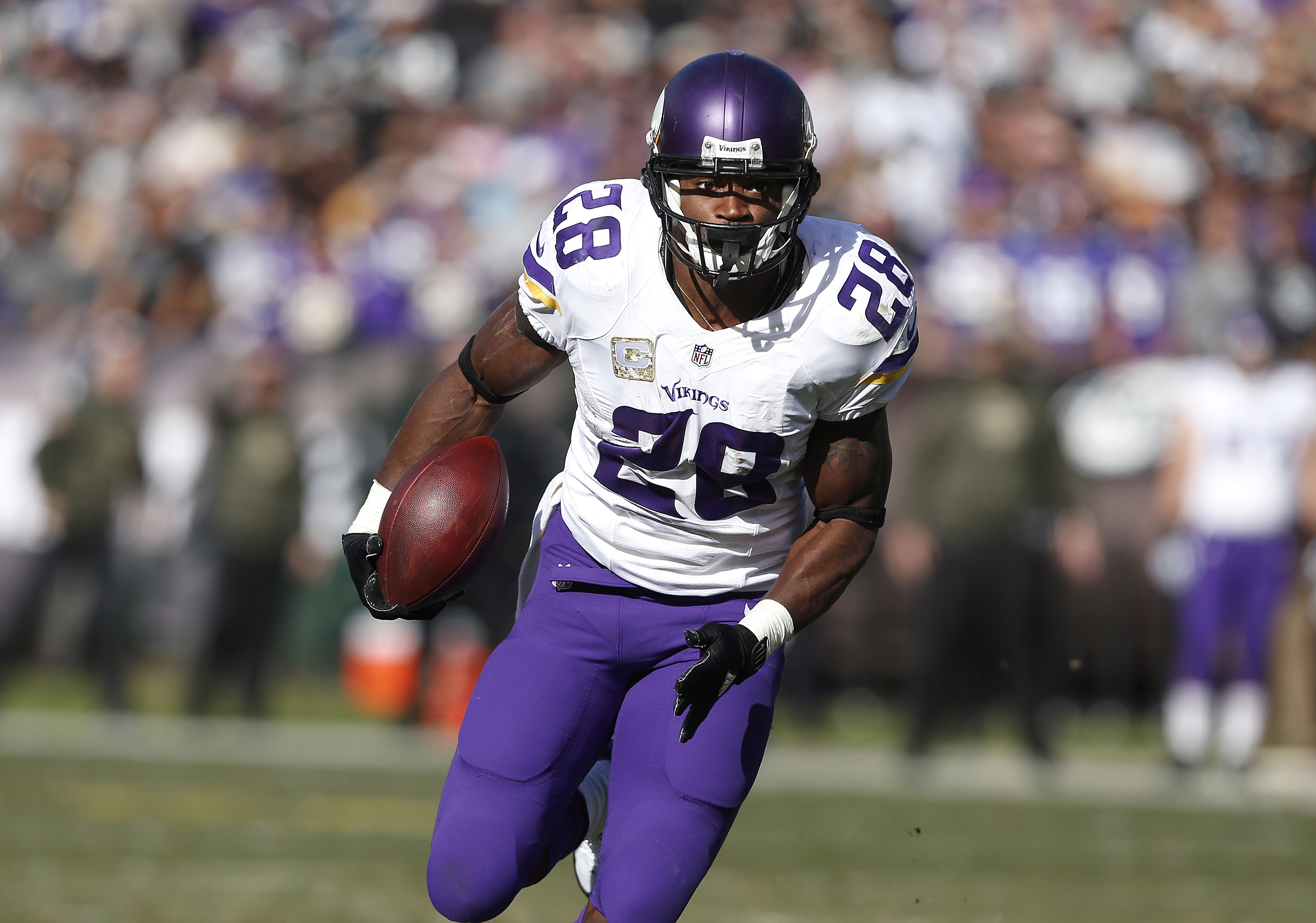 FILE - In this Sunday, Nov. 15, 2015 file photo, Minnesota Vikings running back Adrian Peterson (28) runs against the Oakland Raiders during an NFL football game in Oakland, Calif. The Packers need to get production in the running game to ease the pressur