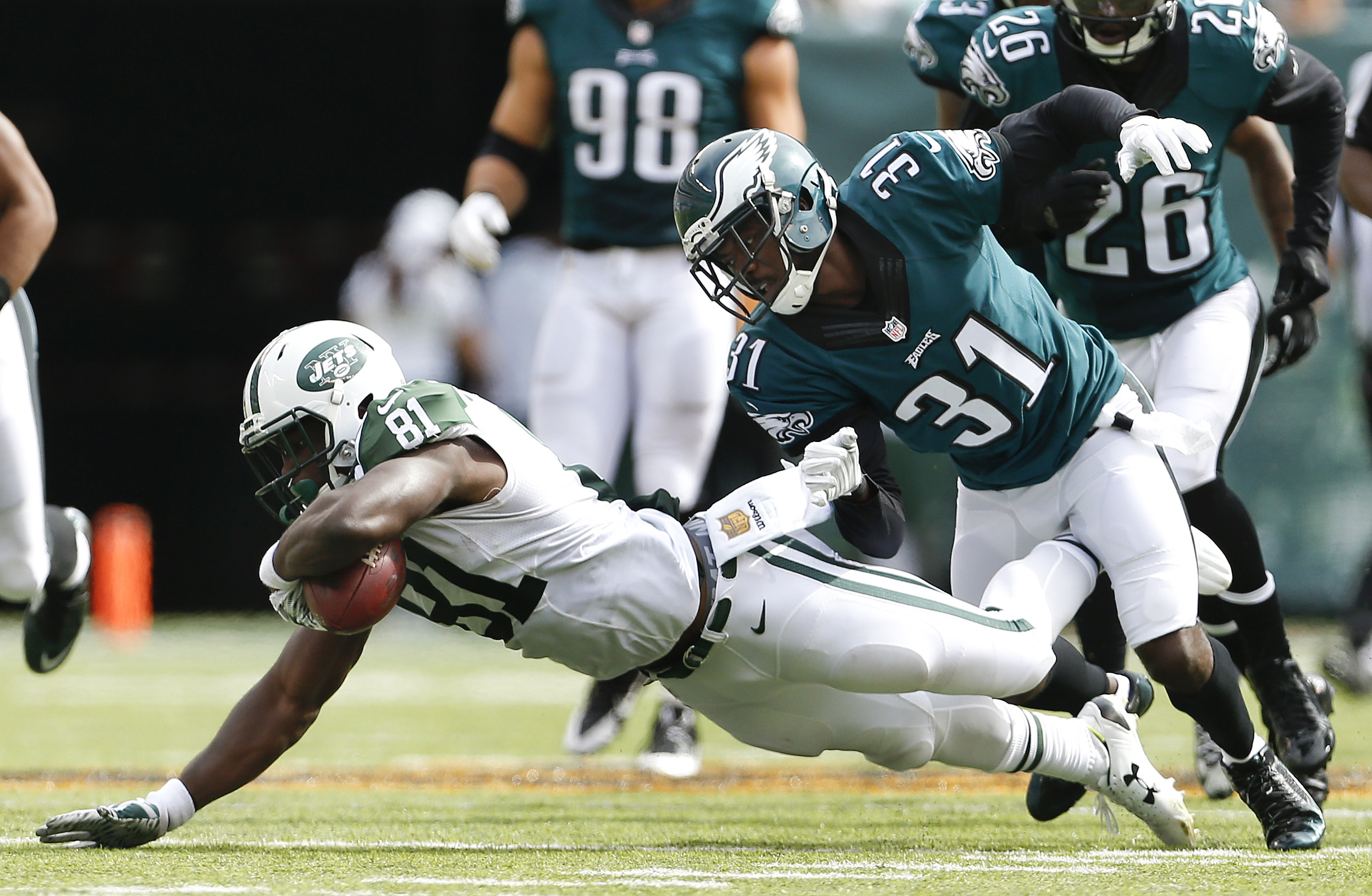 FILE - In this Sept. 27, 2015, file photo, New York Jets wide receiver Quincy Enunwa (81) makes a catch defended by Philadelphia Eagles cornerback Byron Maxwell (31) during the first half of an NFL football game in East Rutherford, N.J. New York Jets wide