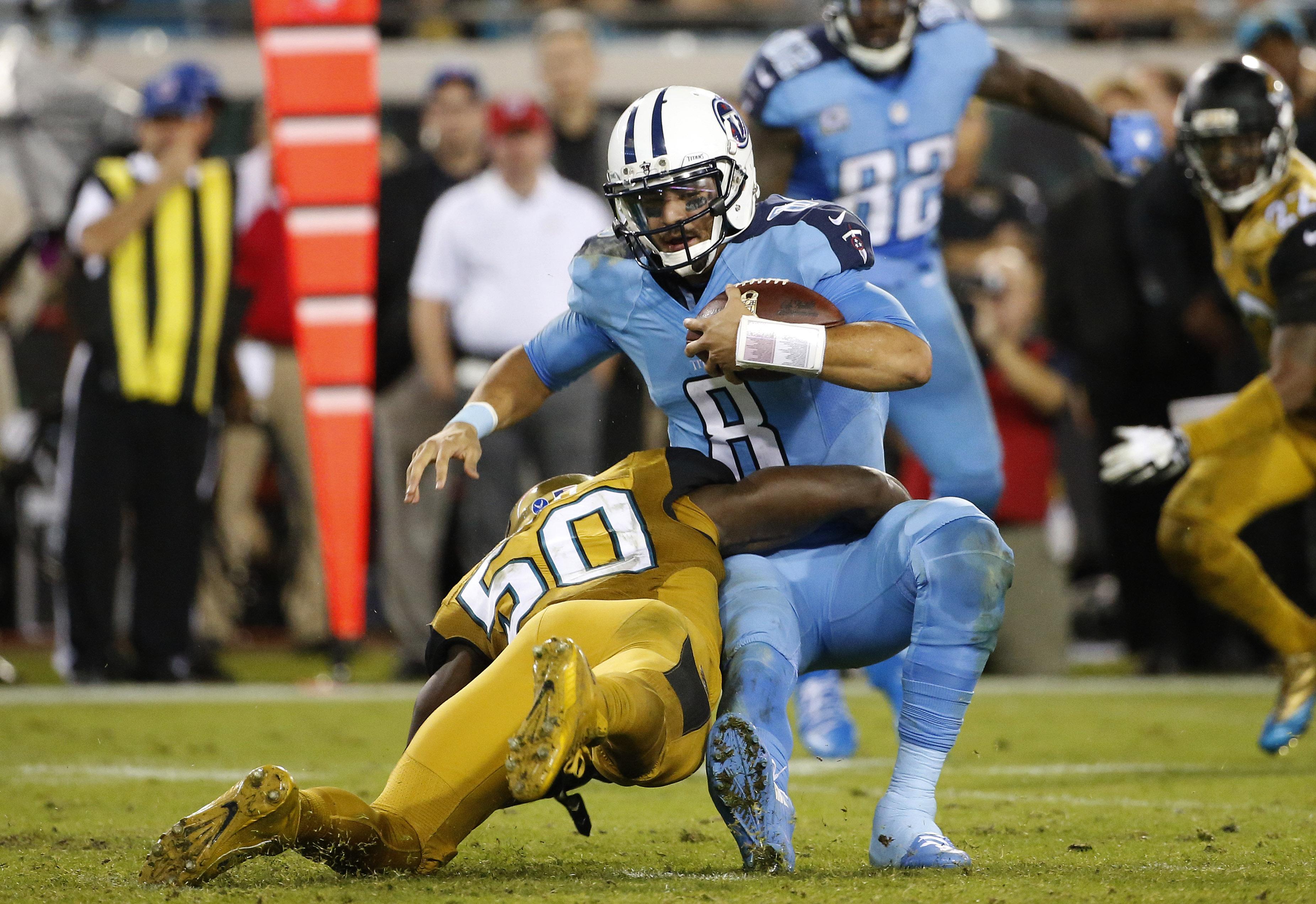 Jacksonville Jaguars outside linebacker Telvin Smith (50) sacks Tennessee Titans quarterback Marcus Mariota (8) during the fourth quarter of an NFL football game Thursday, Nov. 19, 2015, in Jacksonville, Fla. (AP Photo/Brian Blanco)