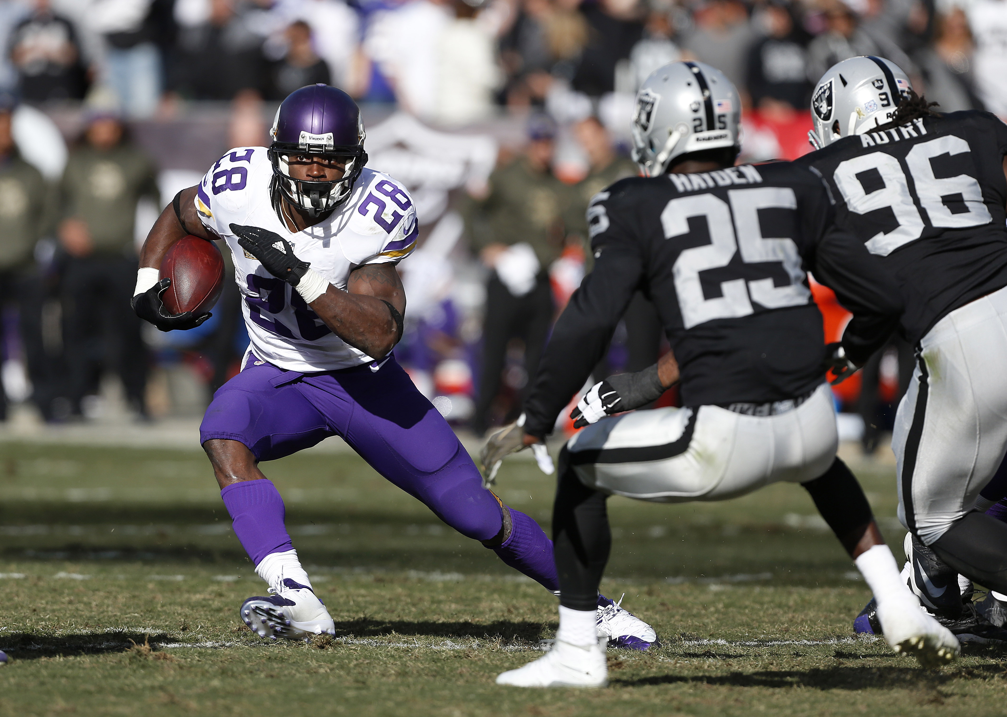 FILE - In this Nov. 15, 2015, file photo, Minnesota Vikings running back Adrian Peterson (28) carries against the Oakland Raiders during the first half of an NFL football game in Oakland, Calif. Peterson's 961 yards rushing easily leads the league. And th