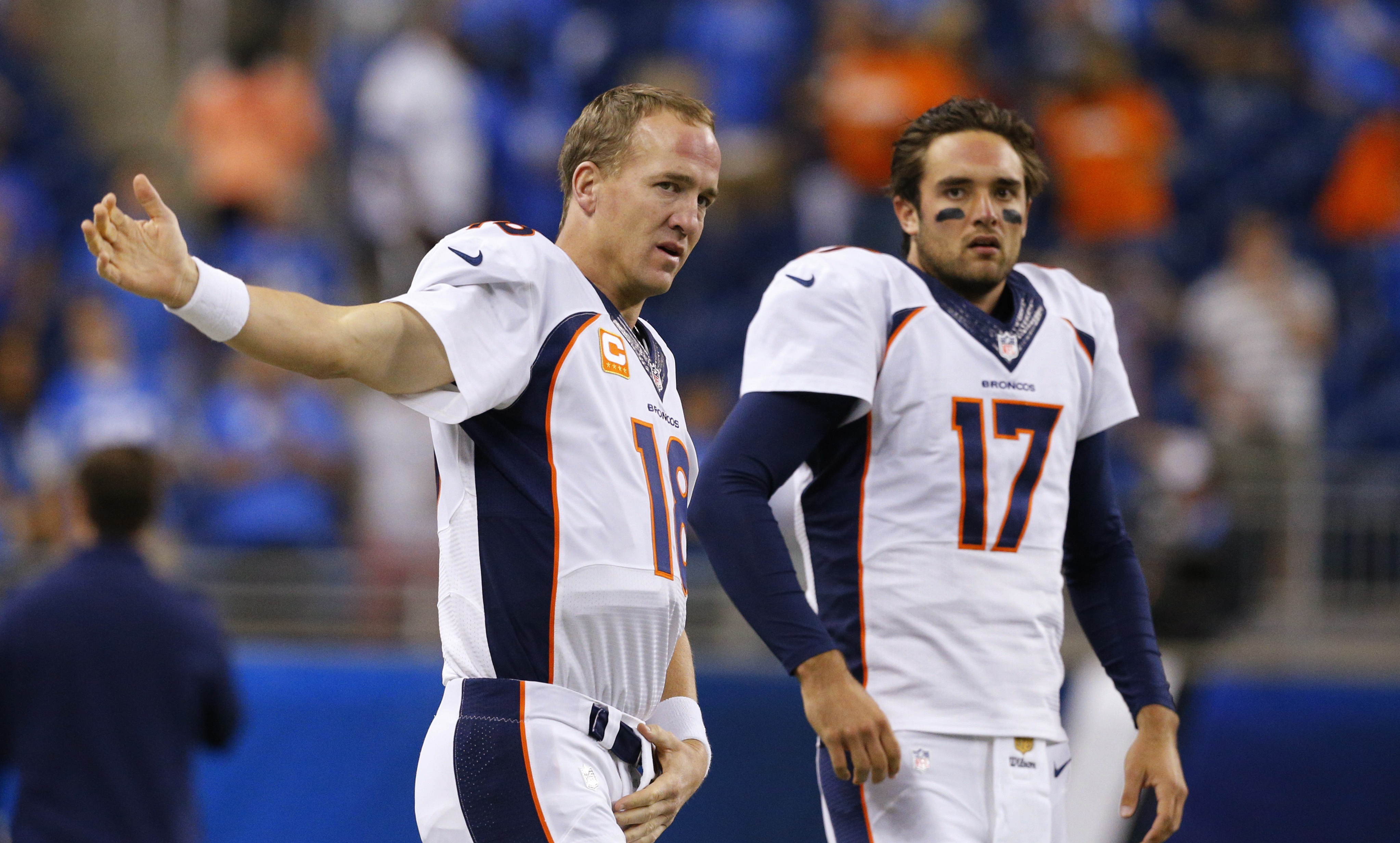 FILE - In this Sept. 27, 2015, file photo, Denver Broncos quarterbacks Peyton Manning (18) and Brock Osweiler (17) get ready for the Broncos' NFL football game against the Detroit Lions in Detroit. Osweiler gets his first NFL start in his fourth pro seaso