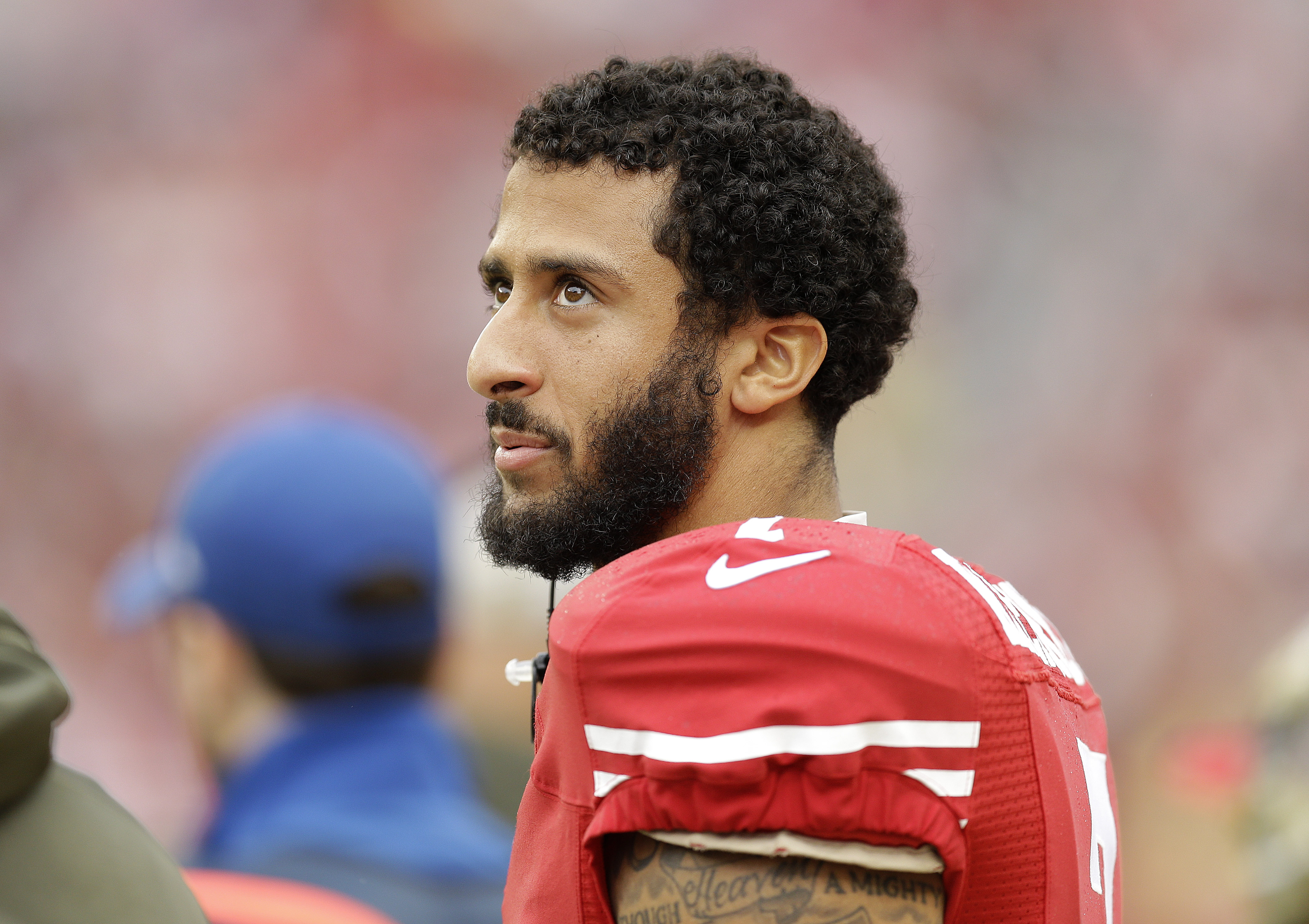 FILE - In this Nov. 8, 2015, file photo, San Francisco 49ers quarterback Colin Kaepernick (7) stands on the sideline during the first half of an NFL football game against the Atlanta Falcons in Santa Clara, Calif.  The The 49ers announced Saturday, Nov. 2