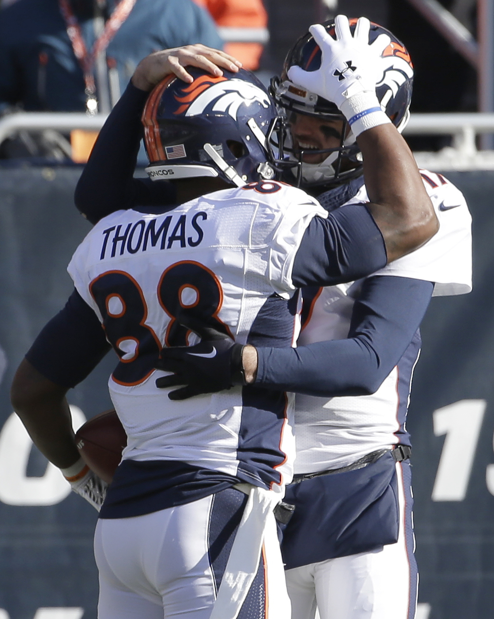 Denver Broncos wide receiver Demaryius Thomas (88) celebrates a touchdown with Denver Broncos quarterback Brock Osweiler (17) during the first half of an NFL football game against the Chicago Bears, Sunday, Nov. 22, 2015, in Chicago. (AP Photo/Nam Y. Huh)