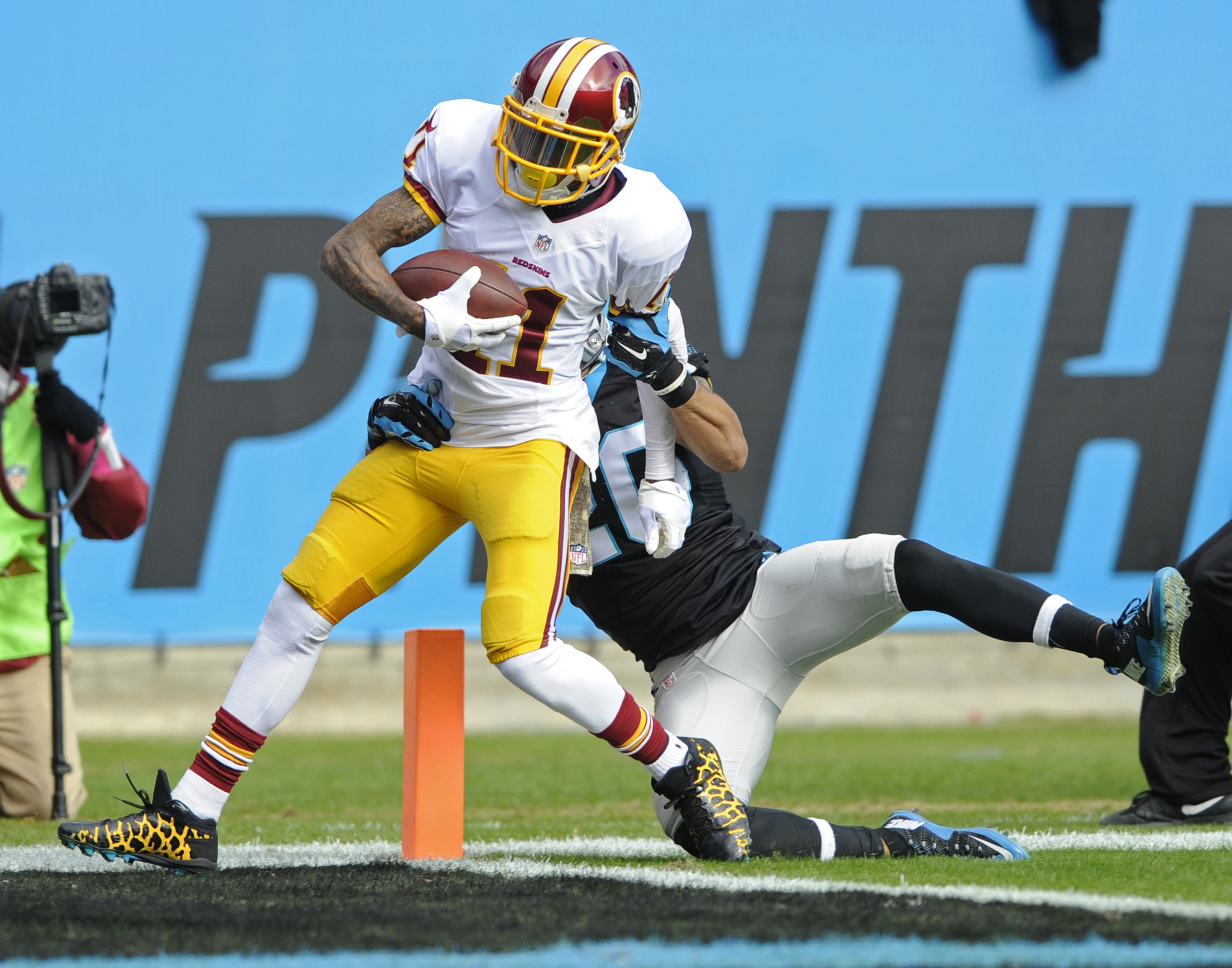 Washington Redskins' DeSean Jackson (11) runs into the end zone for a touchdown against Carolina Panthers' Kurt Coleman (20) in the first half of an NFL football game in Charlotte, N.C., Sunday, Nov. 22, 2015. (AP Photo/Mike McCarn)
