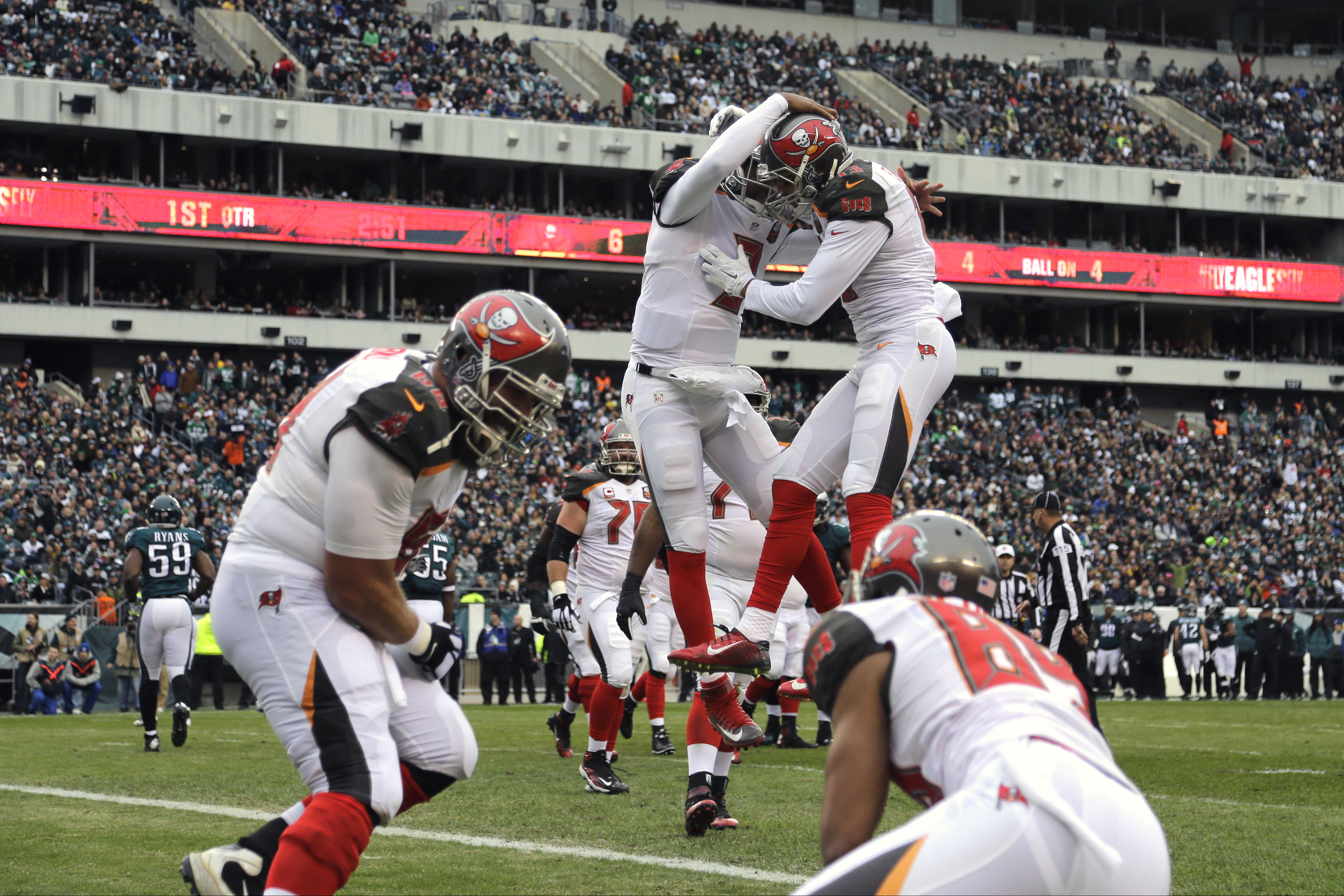 Tampa Bay Buccaneers' Mike Evans (13) and Jameis Winston (3) celebrate after Evans' touchdown during the first half of an NFL football game against the Philadelphia Eagles, Sunday, Nov. 22, 2015, in Philadelphia. (AP Photo/Matt Rourke)