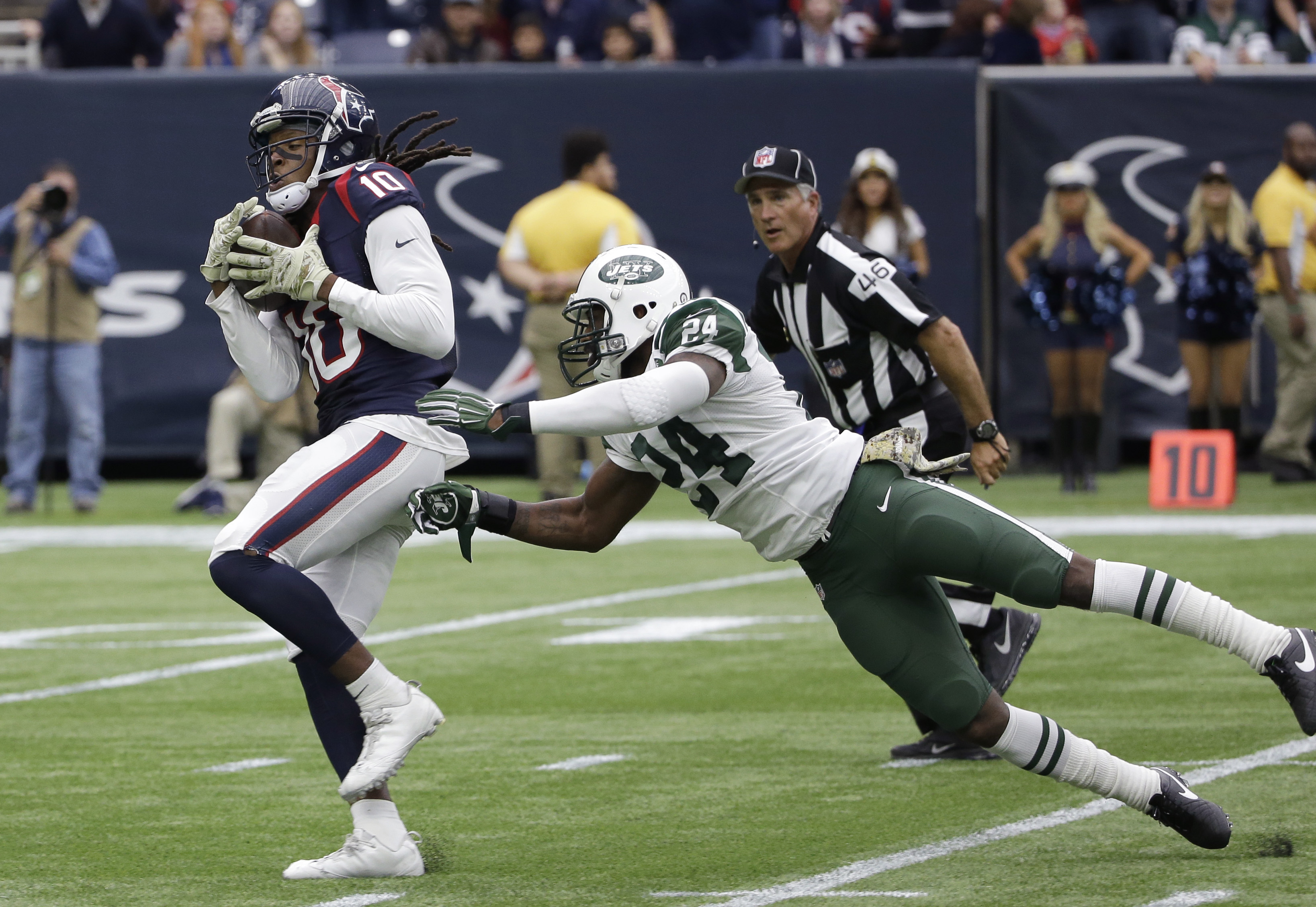 Houston Texans wide receiver DeAndre Hopkins (10) pulls in a pass for a touchdown as he is defended by New York Jets cornerback Darrelle Revis (24) during the first half of an NFL football game, Sunday, Nov. 22, 2015, in Houston. (AP Photo/David J. Philli