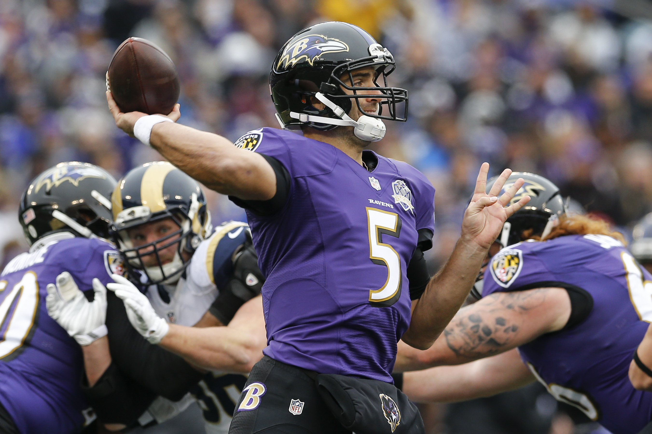 Baltimore Ravens quarterback Joe Flacco (5) passes the ball during the first half of an NFL football game against the St. Louis Rams in Baltimore, Sunday, Nov. 22, 2015. (AP Photo/Patrick Semansky)
