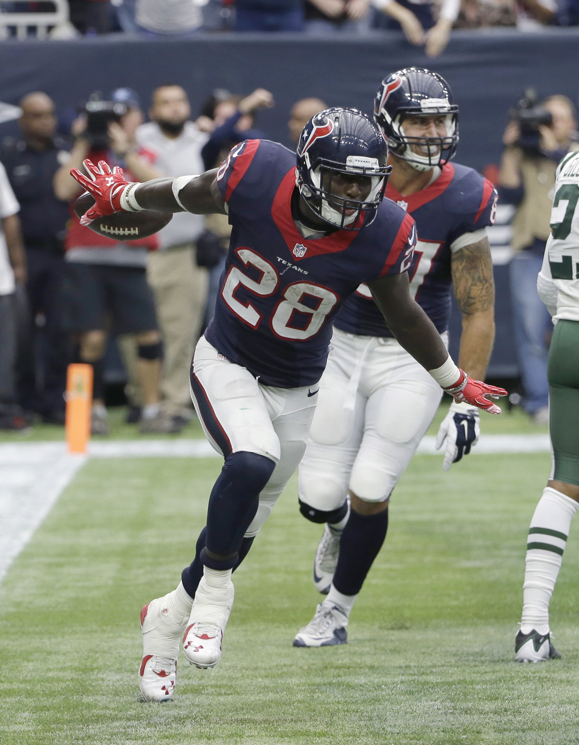 Houston Texans running back Alfred Blue (28) celebrates his touchdown catch from wide receiver Cecil Shorts during the second half of an NFL football game against the New York Jets, Sunday, Nov. 22, 2015, in Houston. (AP Photo/David J. Phillip)