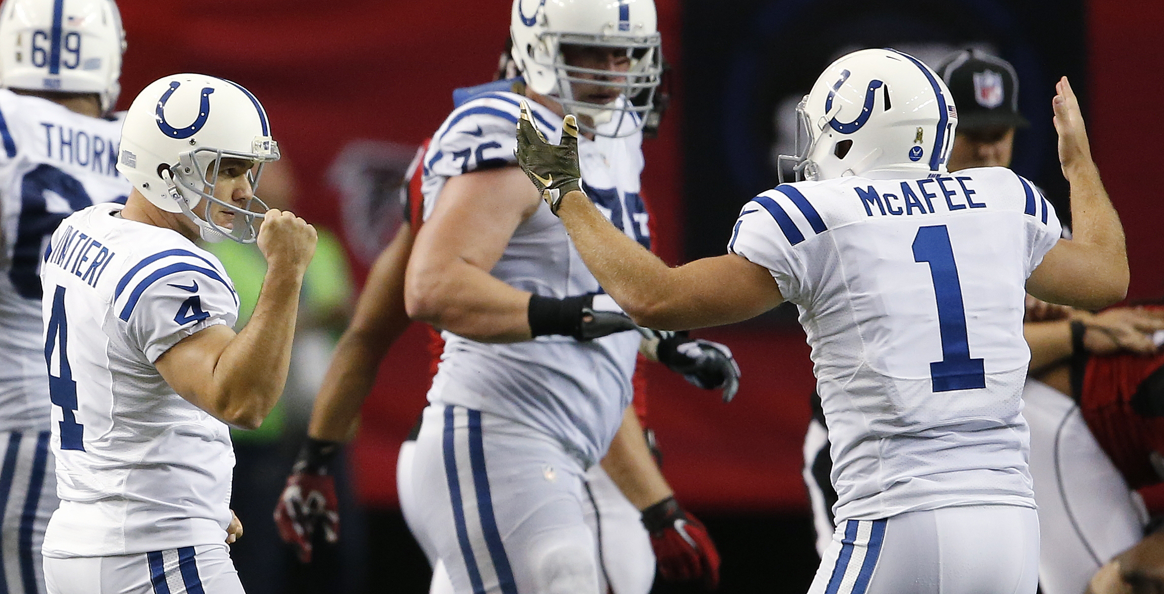 Indianapolis Colts punter Pat McAfee (1) celebrates the field goal of Indianapolis Colts kicker Adam Vinatieri (4) during the second half of an NFL football game against the Atlanta Falcons, Sunday, Nov. 22, 2015, in Atlanta. (AP Photo/John Bazemore)