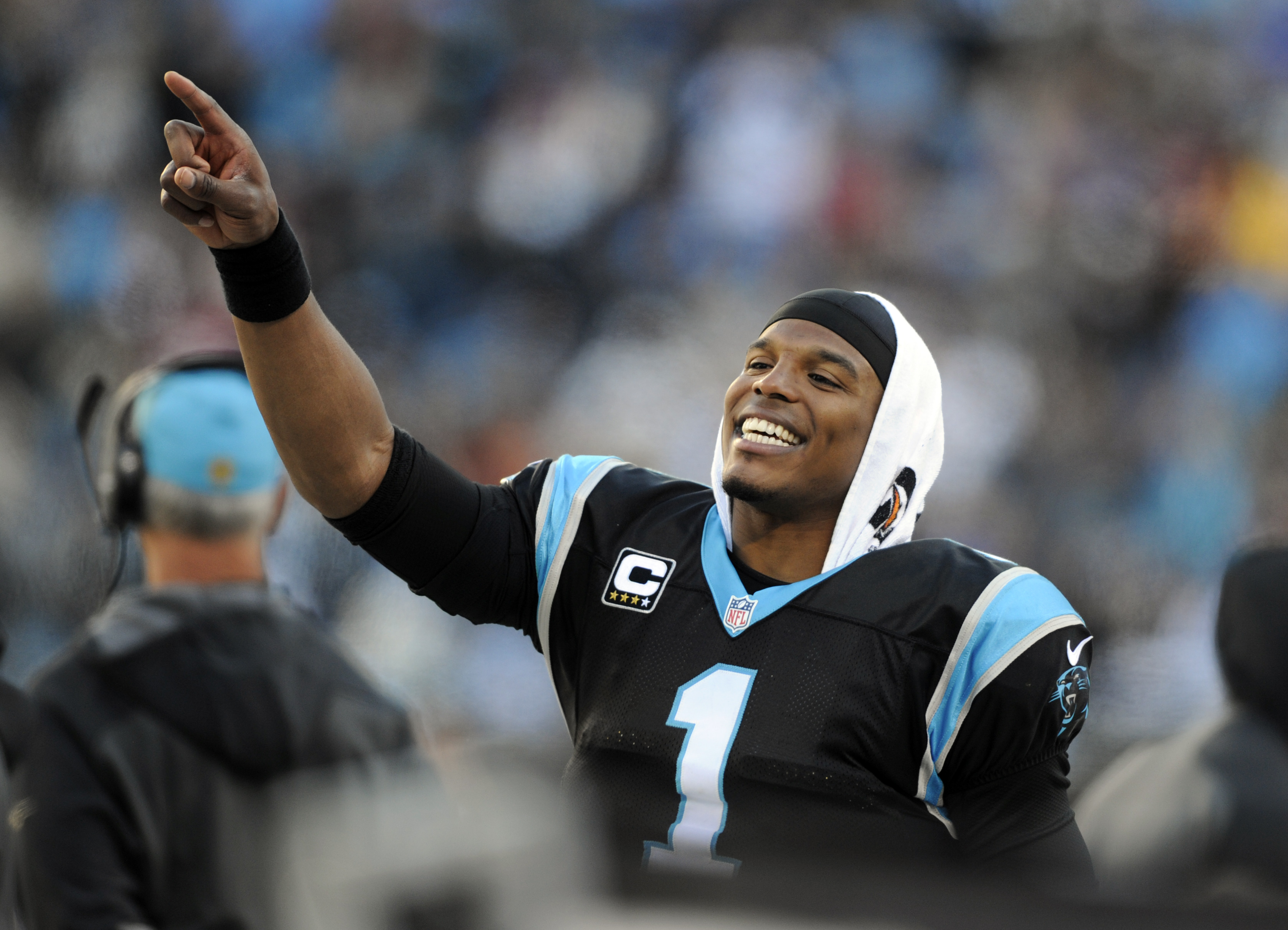 Carolina Panthers' Cam Newton (1) celebrates on the sidelines in the second half of an NFL football game against the Washington Redskins in Charlotte, N.C., Sunday, Nov. 22, 2015. The Panthers won 44-16. (AP Photo/Mike McCarn)