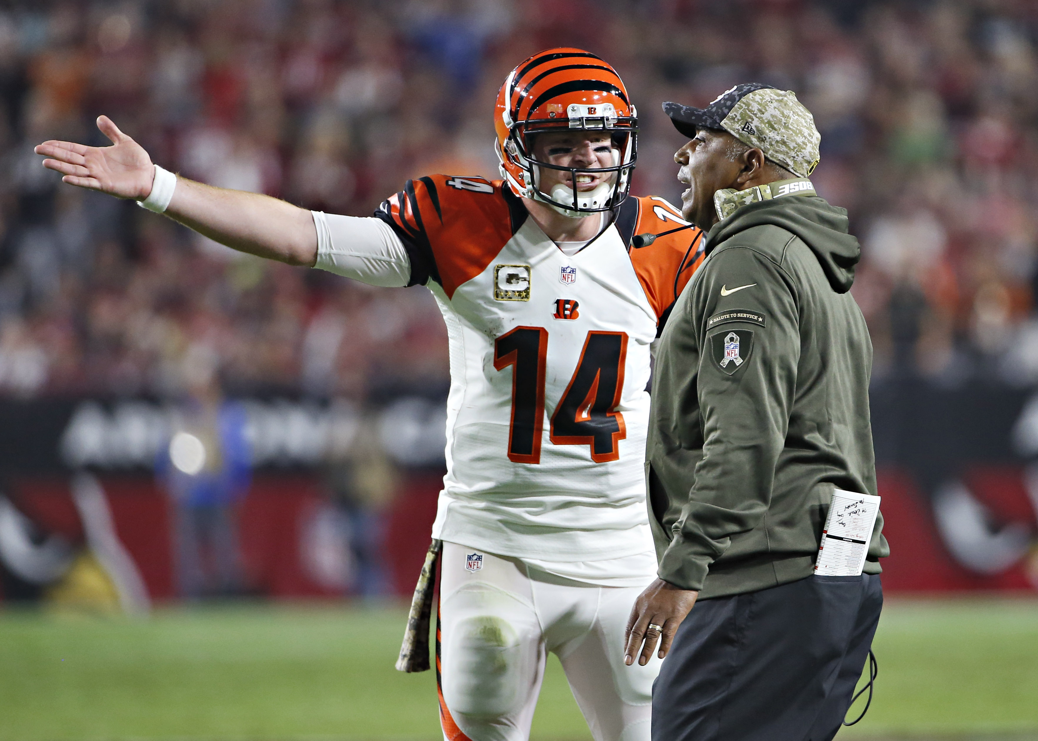 Cincinnati Bengals quarterback Andy Dalton (14) and Cincinnati Bengals head coach Marvin Lewis discuss a call during the first half of an NFL  football game against the Arizona Cardinals, Sunday, Nov. 22, 2015, in Glendale, Ariz. (AP Photo/Ross D. Frankli