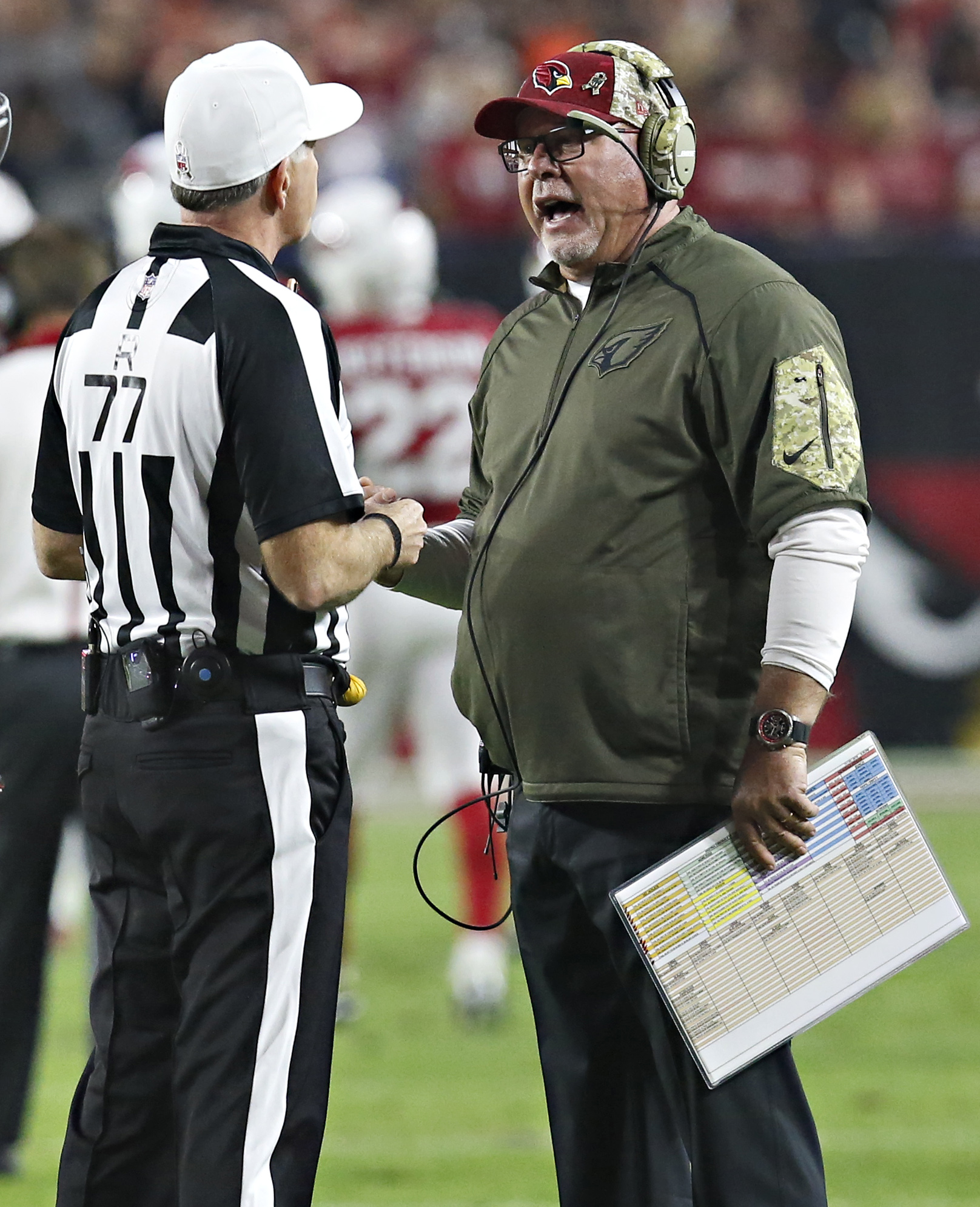 Arizona Cardinals head coach Bruce Arians talks with referee Terry McAulay (77) during the first half of an NFL  football game against the Cincinnati Bengals, Sunday, Nov. 22, 2015, in Glendale, Ariz. (AP Photo/Rick Scuteri)