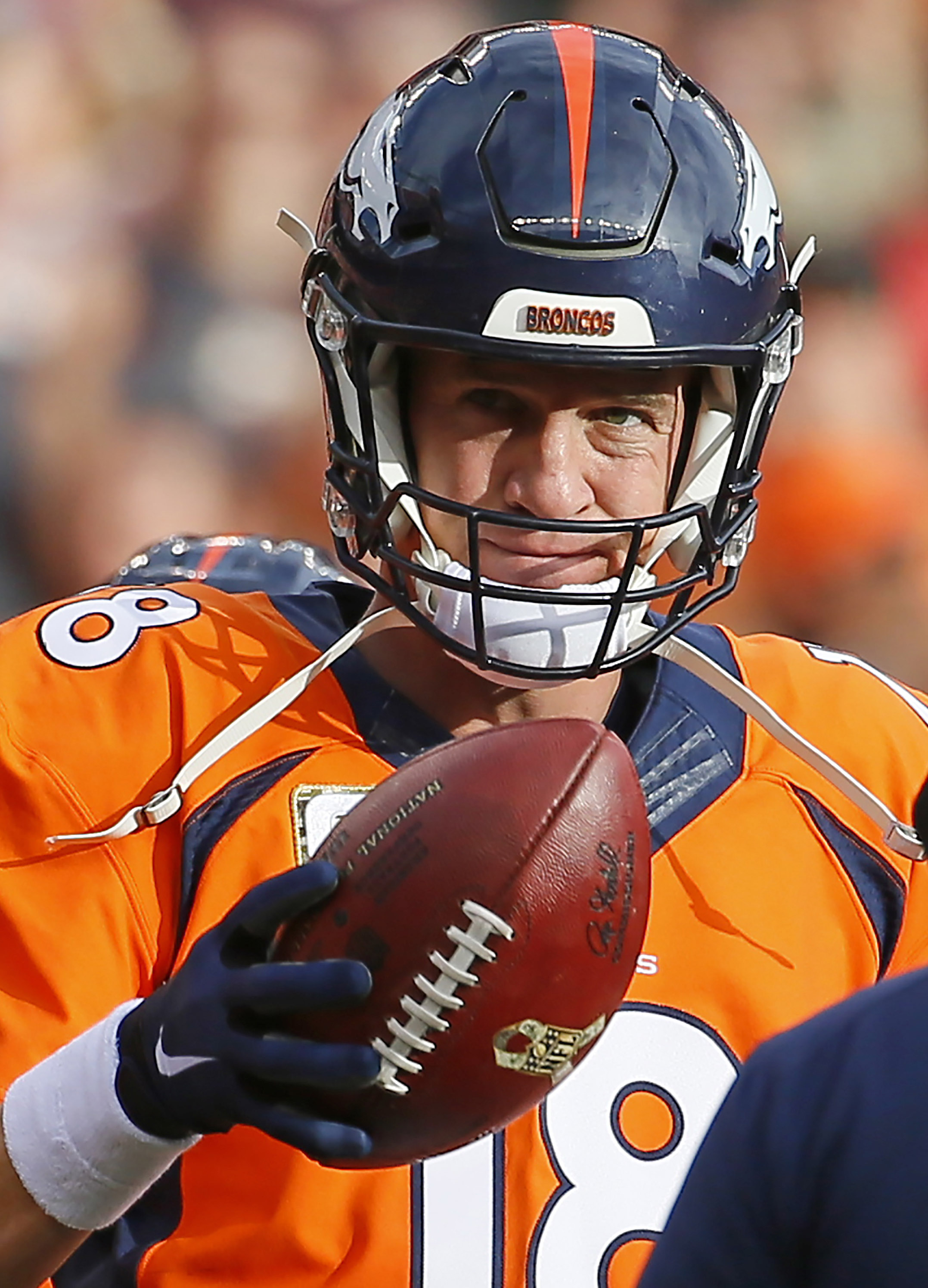 FILE - In this Sunday, Nov. 15, 2015 file photo, Denver Broncos quarterback Peyton Manning (18) smiles and acknowledges the crowd after setting the new passing recored against the Kansas City Chiefs during the first half of an NFL football game in Denver.
