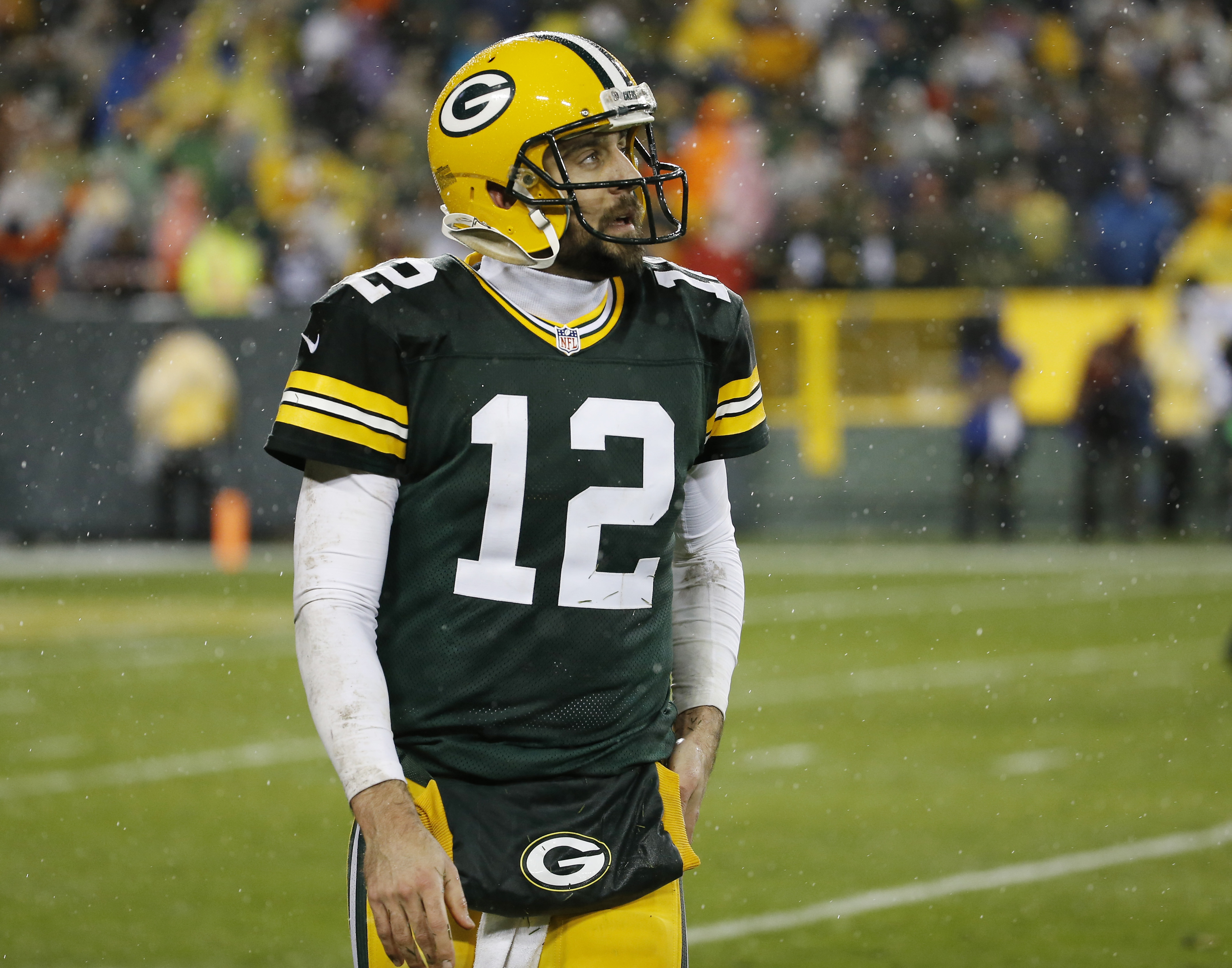Green Bay Packers' Aaron Rodgers walks off the field after failing to complete on fourth down in the final seconds of an NFL football game against the Chicago Bears Thursday, Nov. 26, 2015, in Green Bay, Wis. The Bears won 17-13. (AP Photo/Morry Gash)