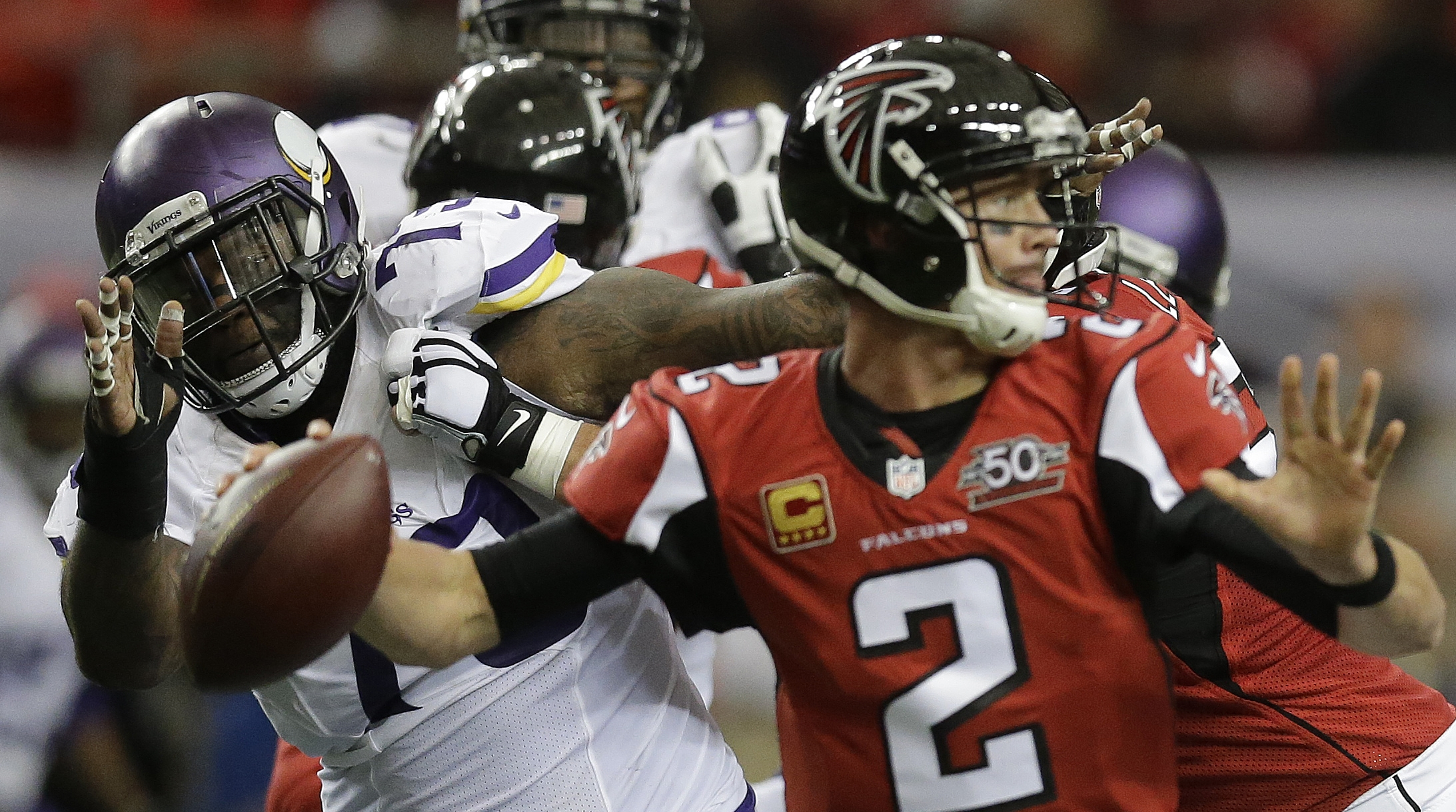 Minnesota Vikings defensive tackle Sharrif Floyd (73) keeps his eye on the ball as Atlanta Falcons quarterback Matt Ryan (2) passes during the first half of an NFL football game, Sunday, Nov. 29, 2015, in Atlanta. (AP Photo/David Goldman)