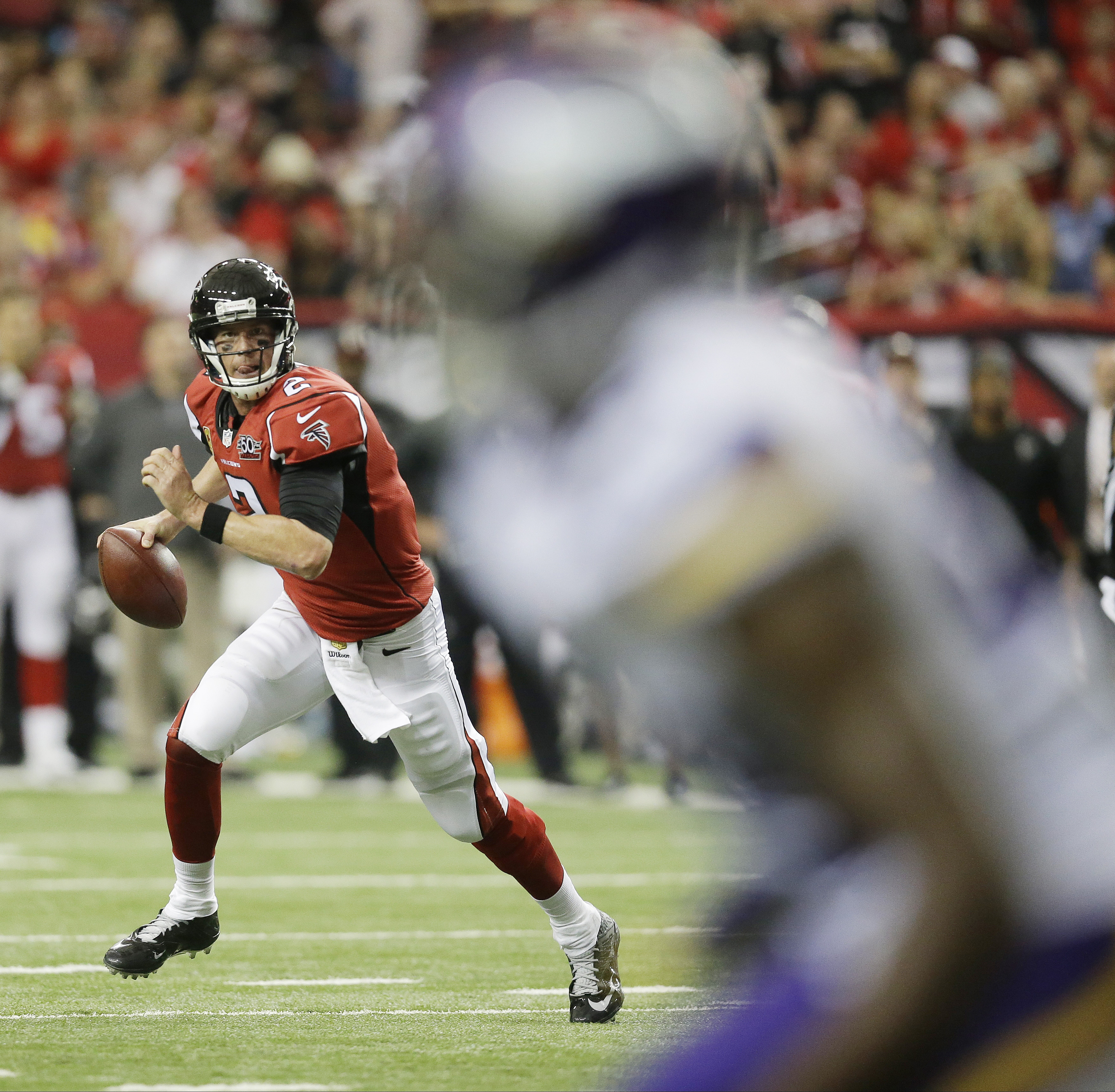 Atlanta Falcons quarterback Matt Ryan (2) runs out of the pocket against the Minnesota Vikings during the second half of an NFL football game, Sunday, Nov. 29, 2015, in Atlanta. (AP Photo/David Goldman)