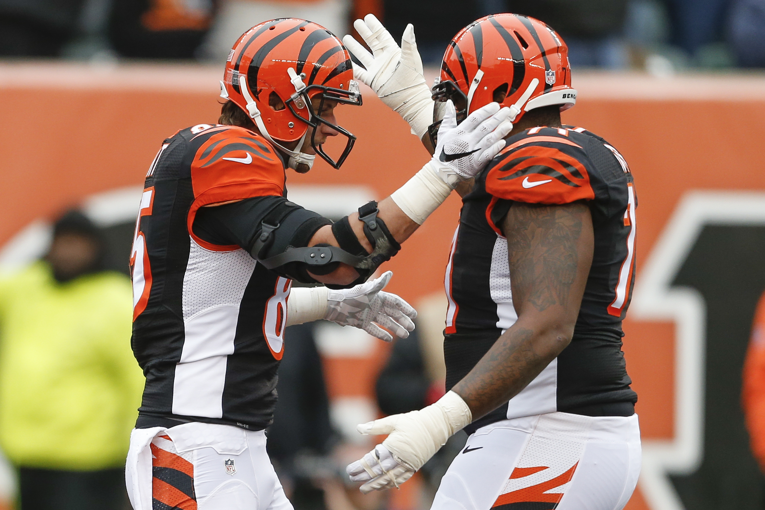 Cincinnati Bengals tight end Tyler Eifert, left, celebrates scoring a touchdown with tackle Andre Smith, right, in the first half of an NFL football game against the St. Louis Rams, Sunday, Nov. 29, 2015, in Cincinnati. (AP Photo/Gary Landers)