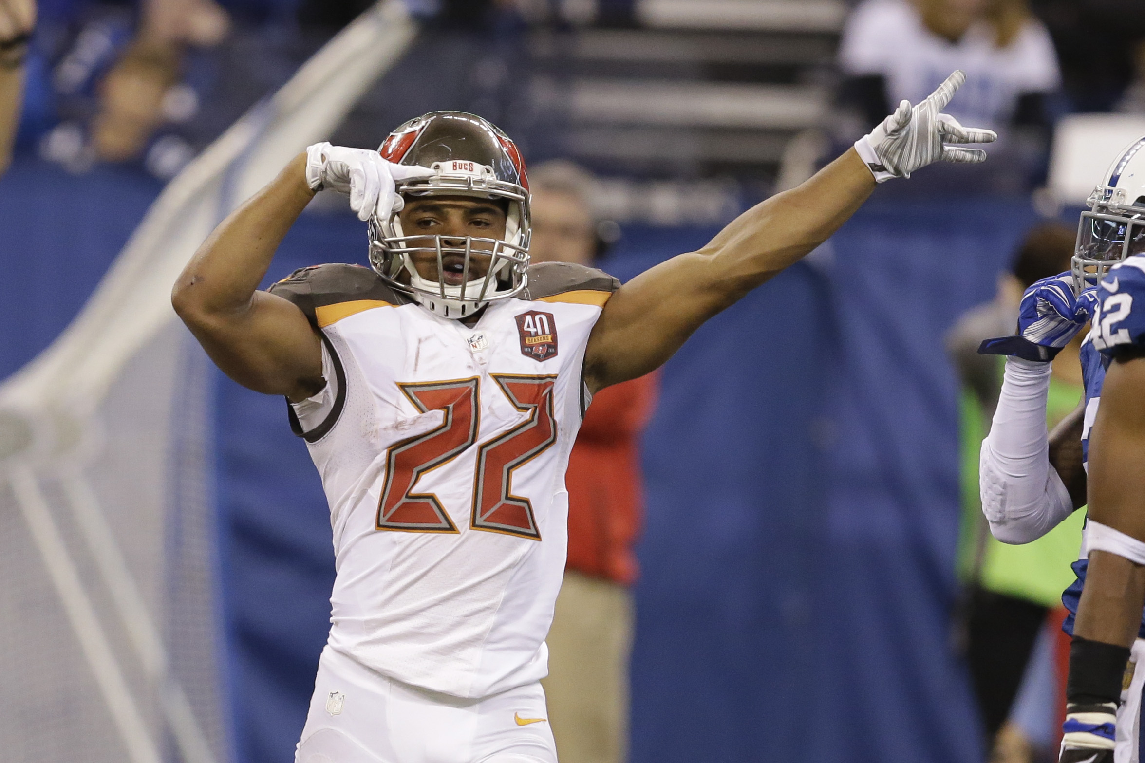 Tampa Bay Buccaneers running back Doug Martin (22) celebrates after picking up a first down against the Indianapolis Colts during the first half of an NFL football game in Indianapolis, Sunday, Nov. 29, 2015. (AP Photo/Darron Cummings)