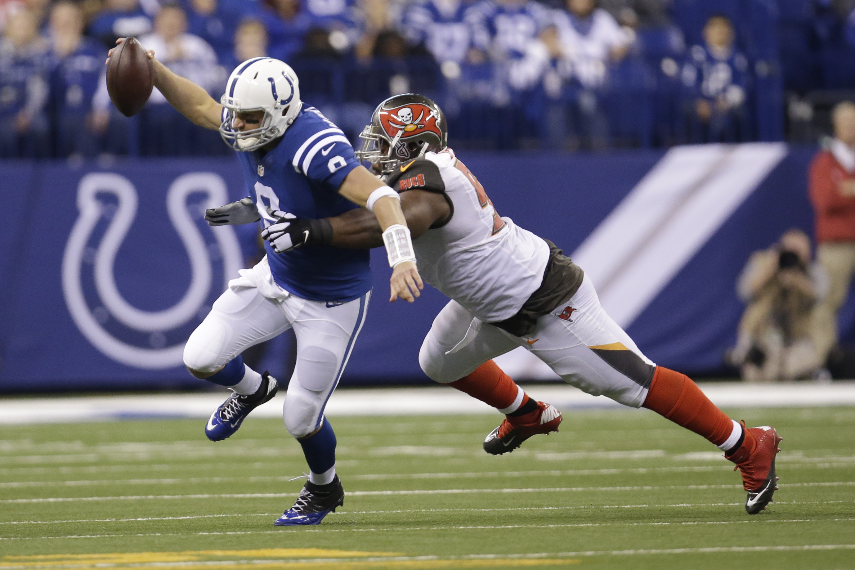 Indianapolis Colts quarterback Matt Hasselbeck (8) is sacked by Tampa Bay Buccaneers defensive tackle Akeem Spence (97) during the first half of an NFL football game in Indianapolis, Sunday, Nov. 29, 2015. (AP Photo/AJ Mast)