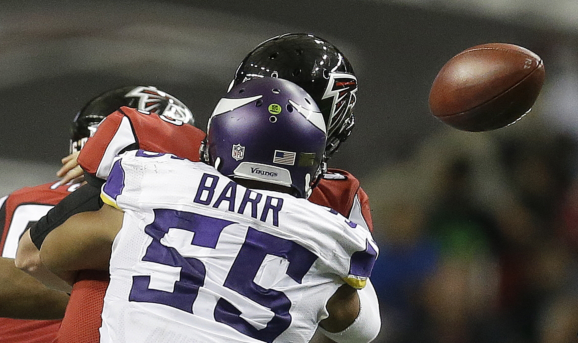 Minnesota Vikings outside linebacker Anthony Barr (55) causes Atlanta Falcons quarterback Matt Ryan (2) to fumble during the second half of an NFL football game, Sunday, Nov. 29, 2015, in Atlanta. Atlanta Falcons defensive tackle Ricky Heimuli recovered t