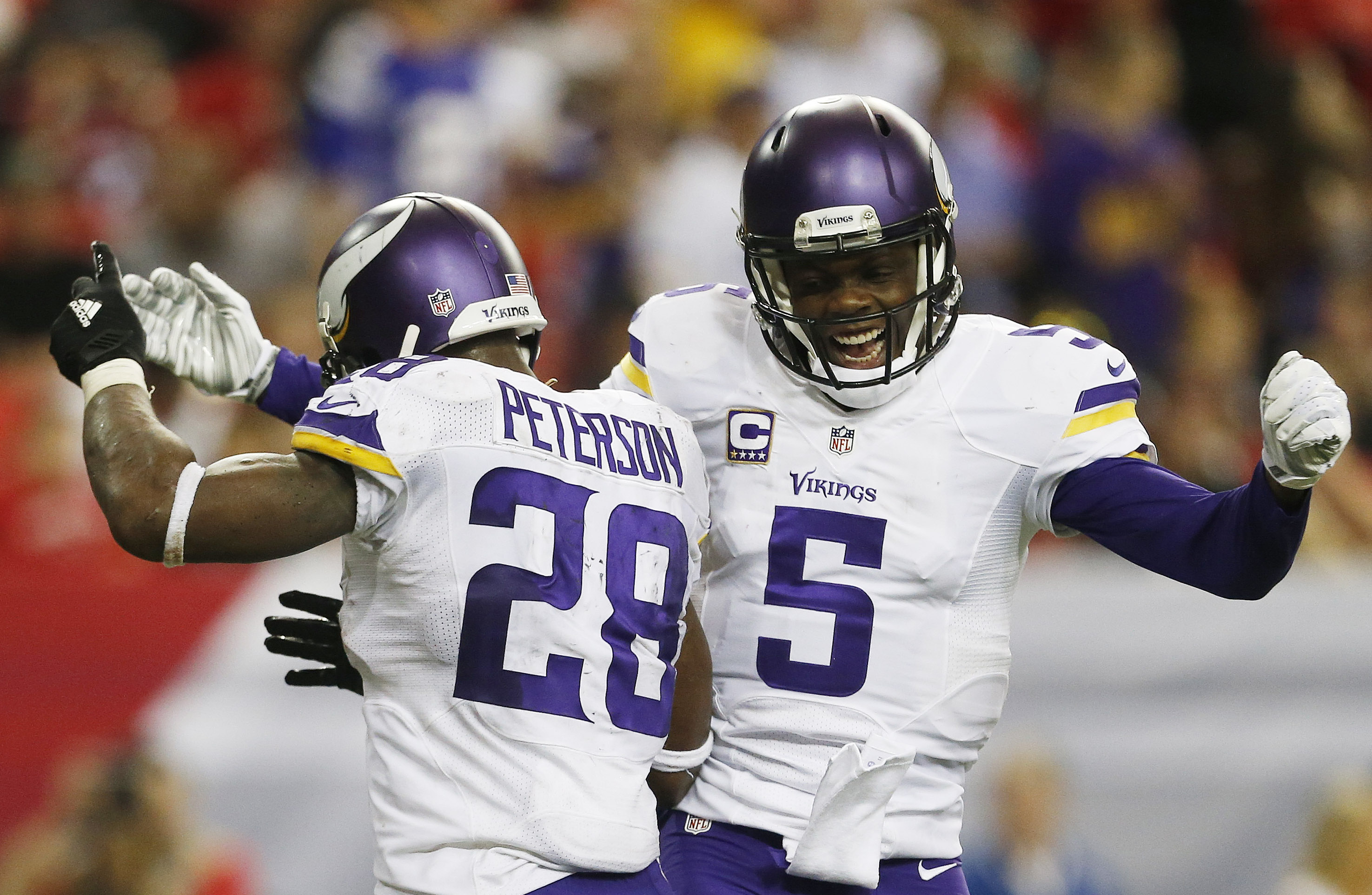 Minnesota Vikings running back Adrian Peterson (28) celebrates his touchdown with Minnesota Vikings quarterback Teddy Bridgewater (5) against the Atlanta Falcons during the second half of an NFL football game, Sunday, Nov. 29, 2015, in Atlanta. (AP Photo/