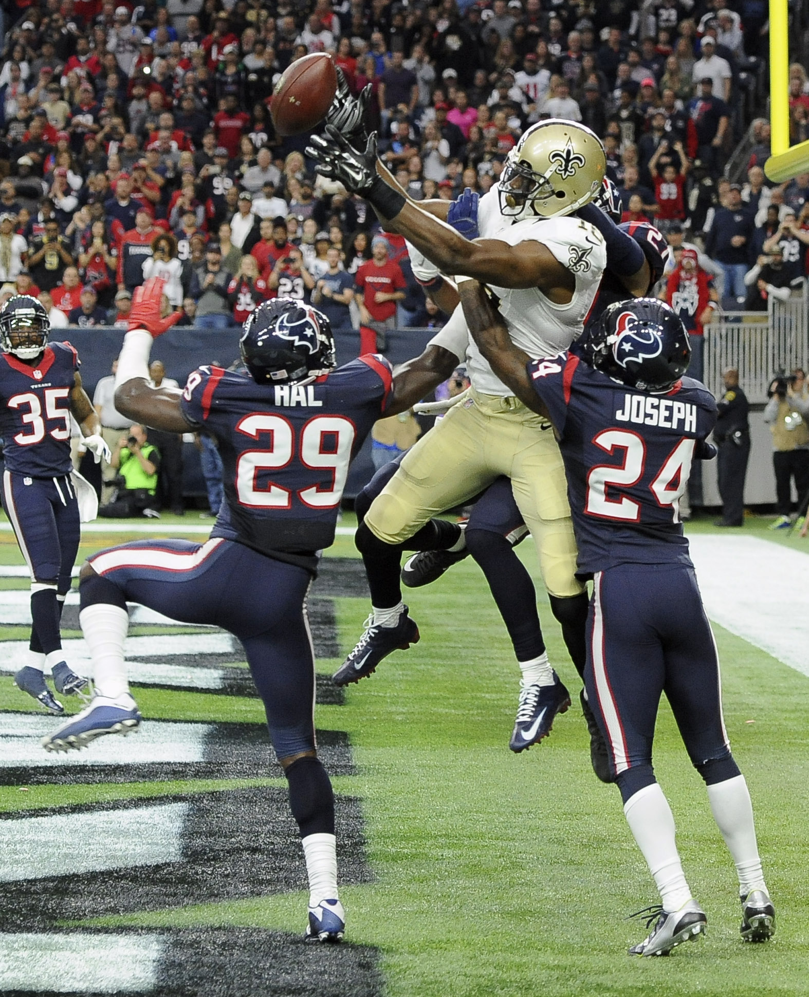 Houston Texans' Andre Hal (29) and Johnathan Joseph (24) help break up a pass intended for New Orleans Saints' Brandin Cooks (10) in the end zone during the fourth quarter of an NFL football game, Sunday, Nov. 29, 2015, in Houston. The Texans won 24-6. (A