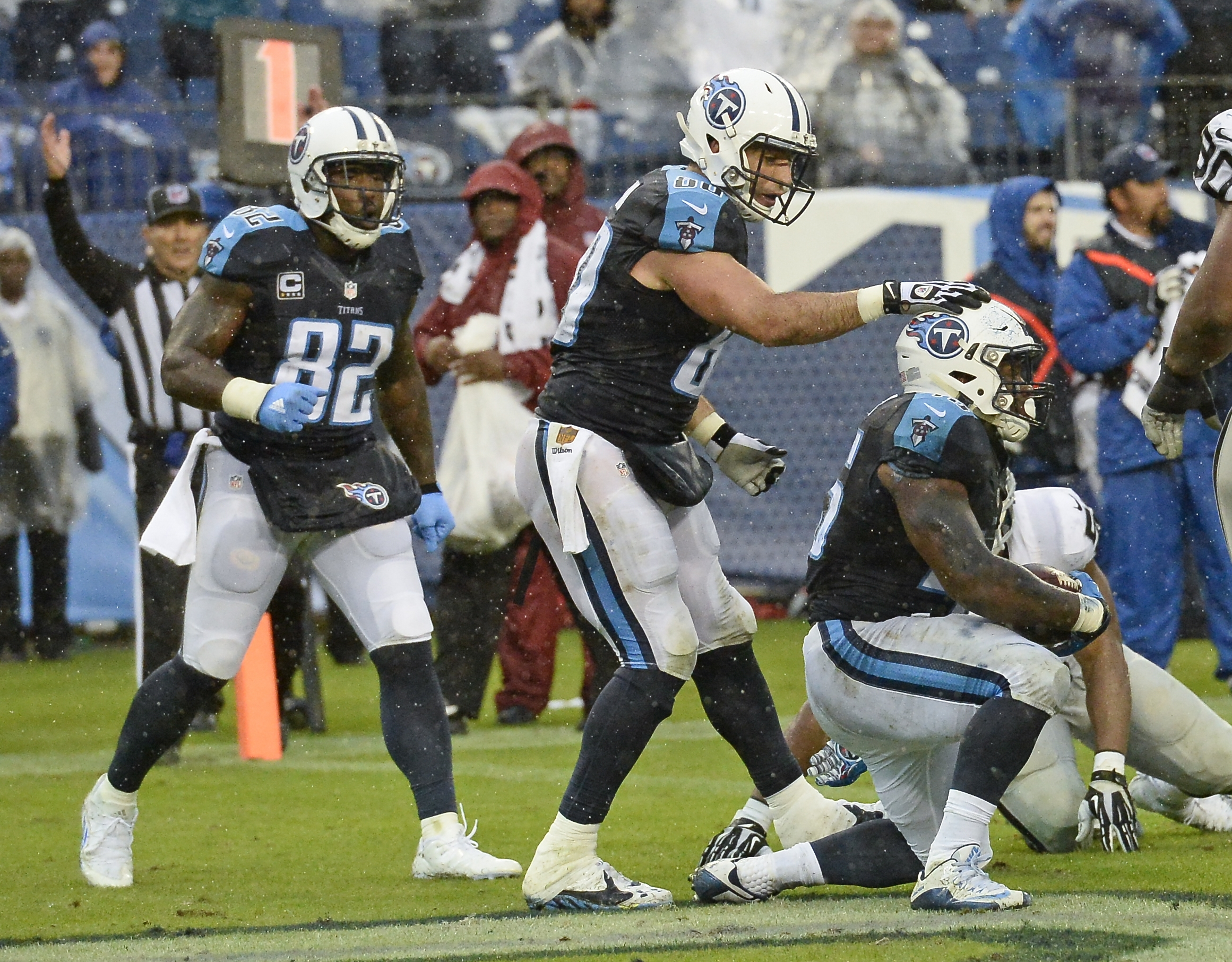 Tennessee Titans fullback Jalston Fowler, right, is congratulated by tight end Anthony Fasano after Fowler caught a 1-yard touchdown pass against the Oakland Raiders in the second half of an NFL football game Sunday, Nov. 29, 2015, in Nashville, Tenn. At