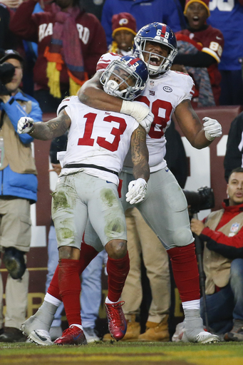 New York Giants wide receiver Odell Beckham (13) is congratulated after his touchdown catch by offensive guard Bobby Hart (68) during the second half of an NFL football game against the Washington Redskins in Landover, Md., Sunday, Nov. 29, 2015. (AP Phot