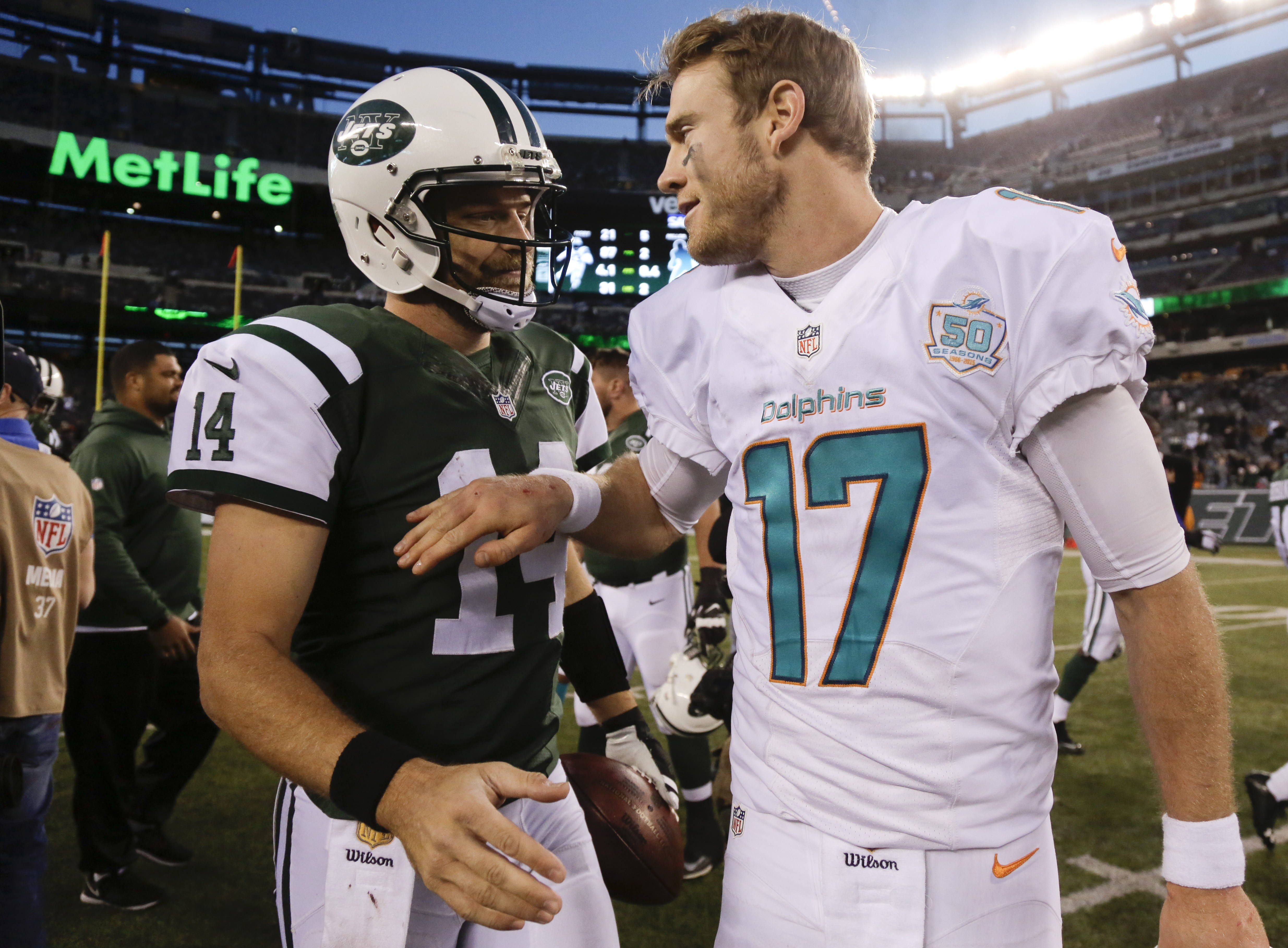 New York Jets quarterback Ryan Fitzpatrick (14) and Miami Dolphins quarterback Ryan Tannehill (17) talk after their NFL football game Sunday, Nov. 29, 2015, in East Rutherford, N.J. The Jets won 38-20. (AP Photo/Julie Jacobson)